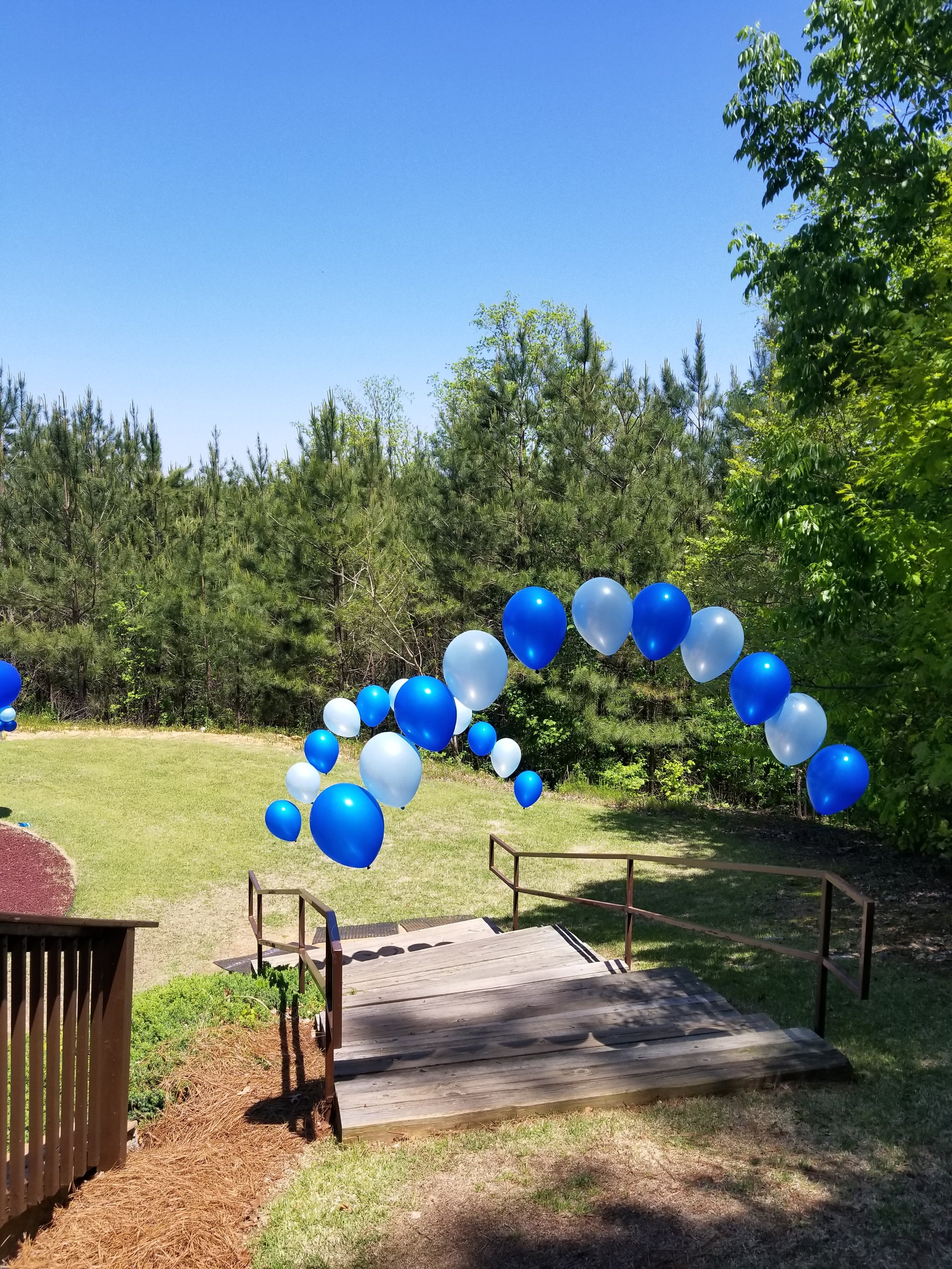 Blue string of pearl balloon arch.jpg