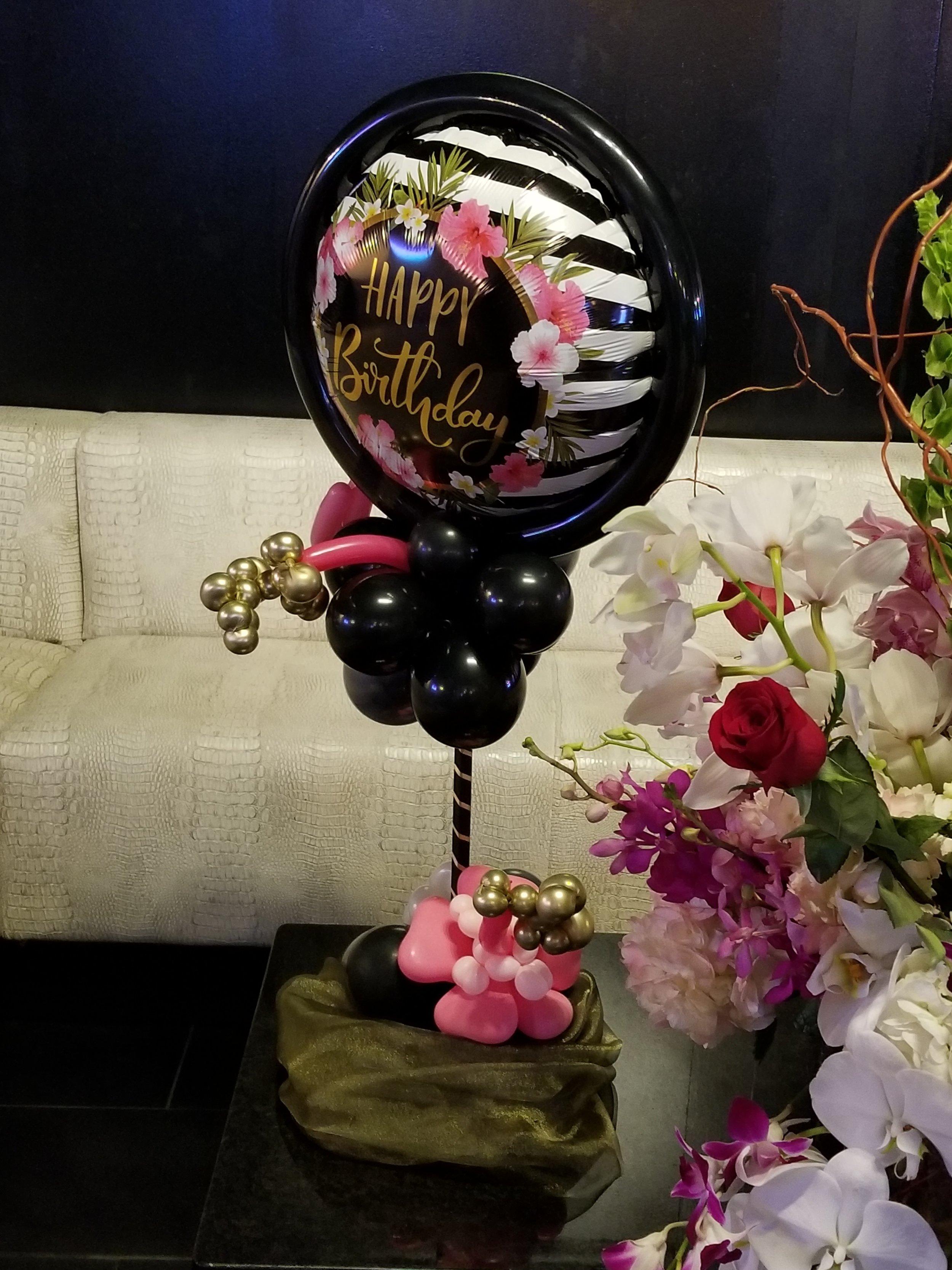 Birthday floral balloon centerpiece.jpg