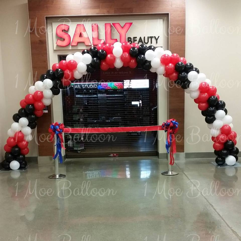 Sally grand opening balloon arch.jpg