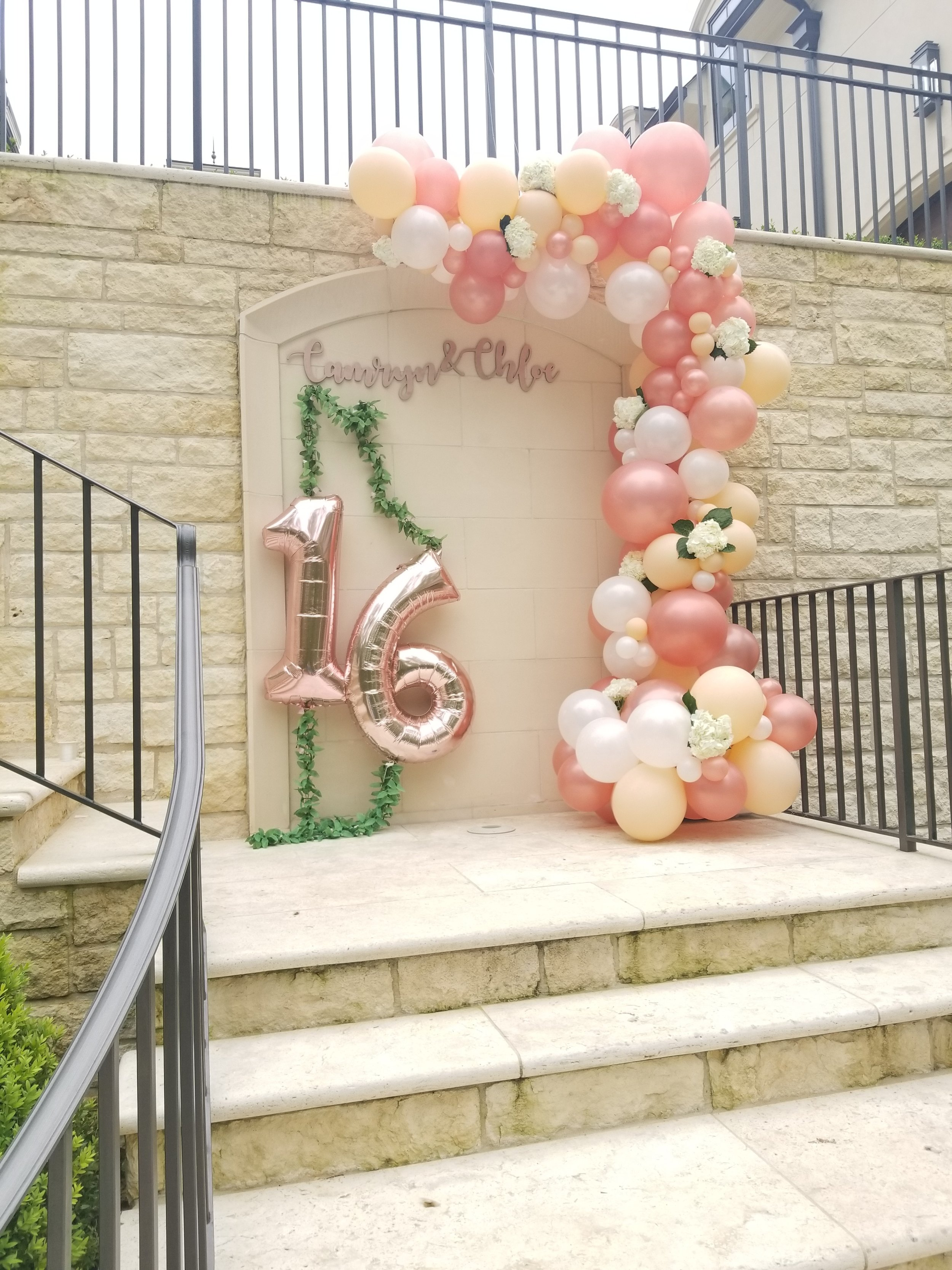 Organic balloon Garland with flowers.jpg