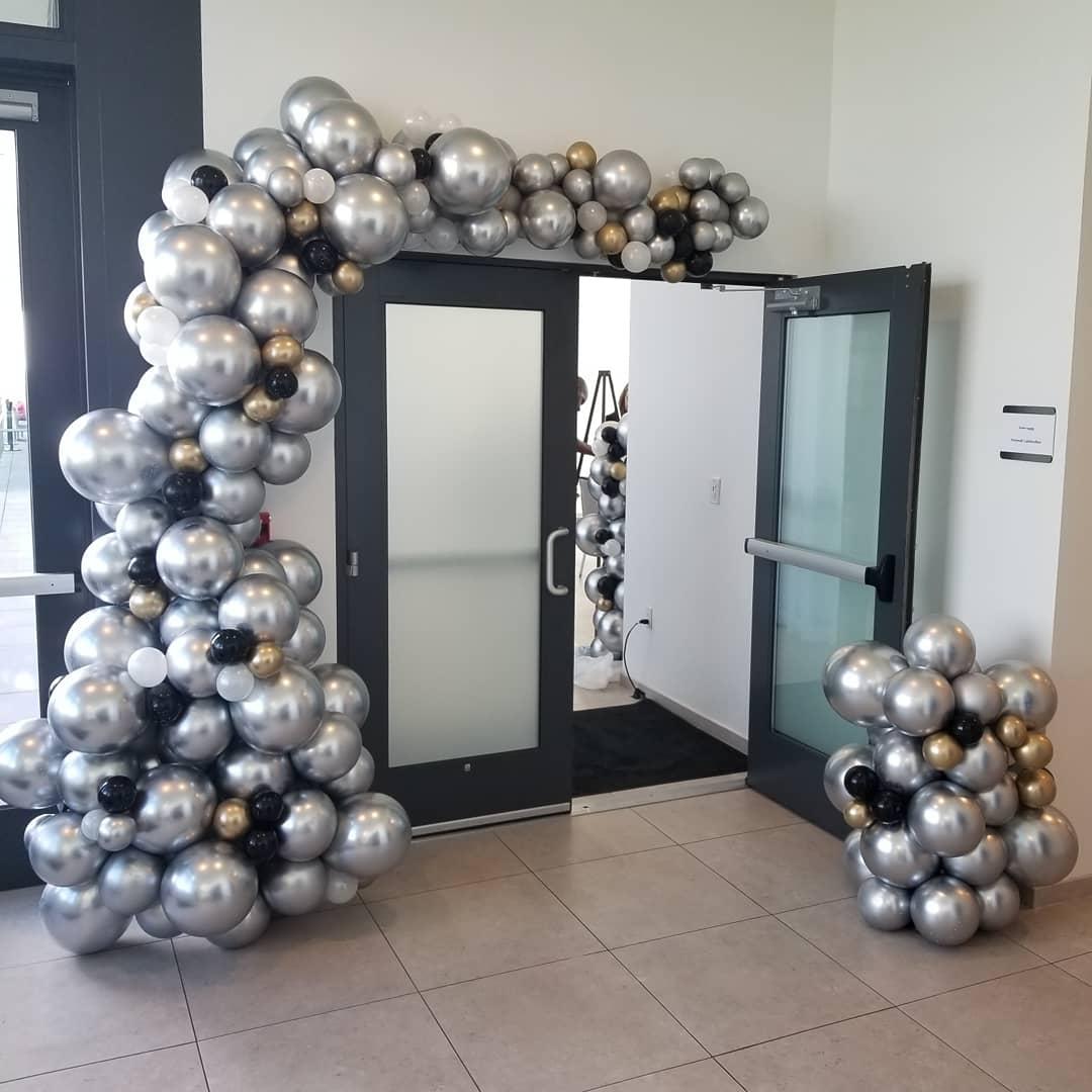 Chrome silver and gold balloon arch.jpg