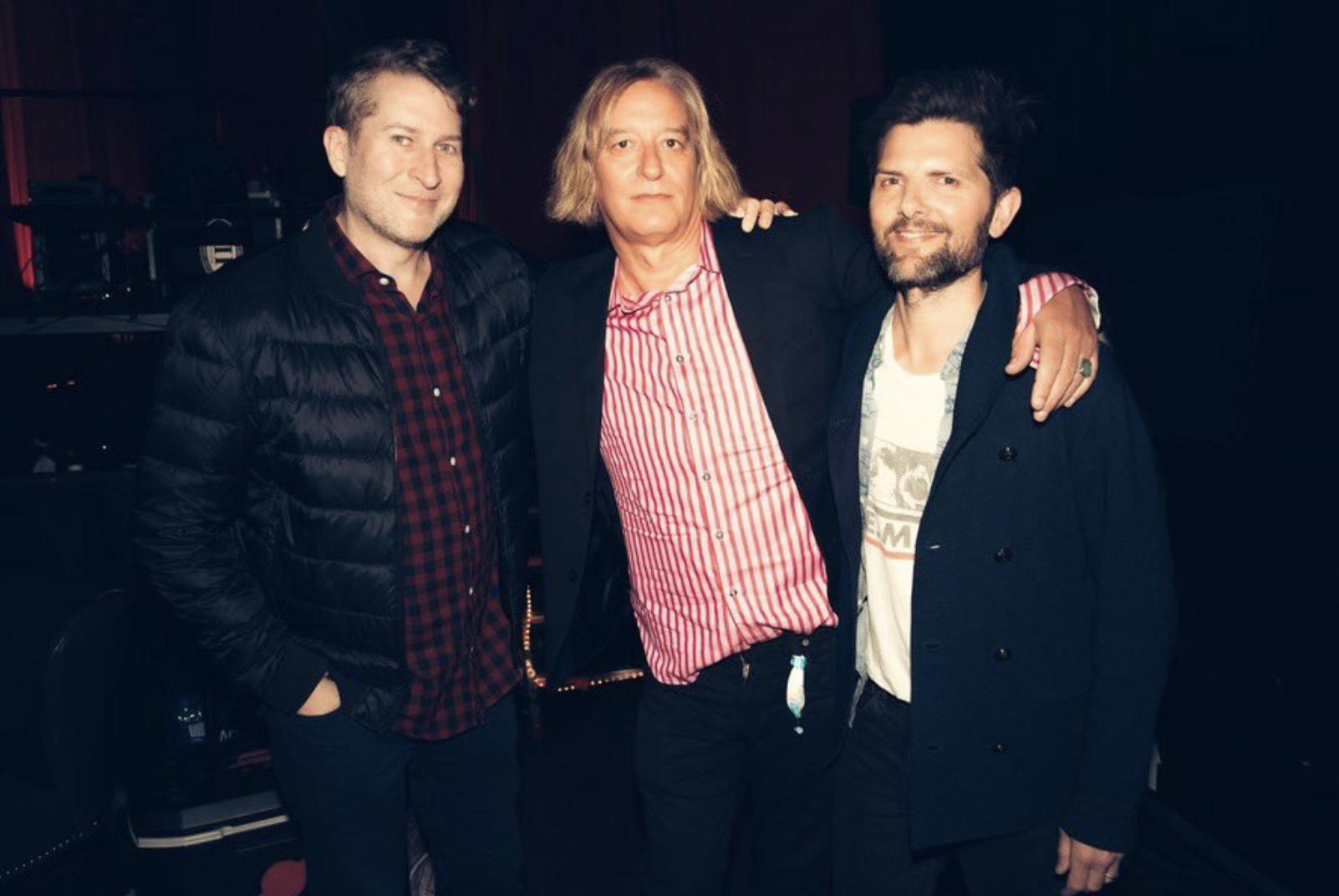 Scott Aukerman, Peter Buck, and Adam Scott.