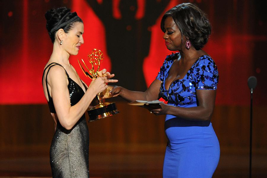 Julianna Margulies (l) of The Good Wife accepts an award from Viola Davis at the 66th Emmy Awards. Invision/AP
