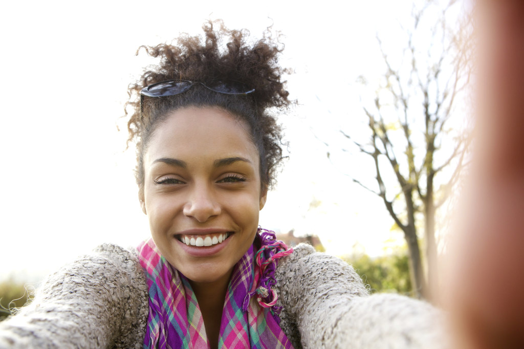 Young woman smiling and talking a selfie