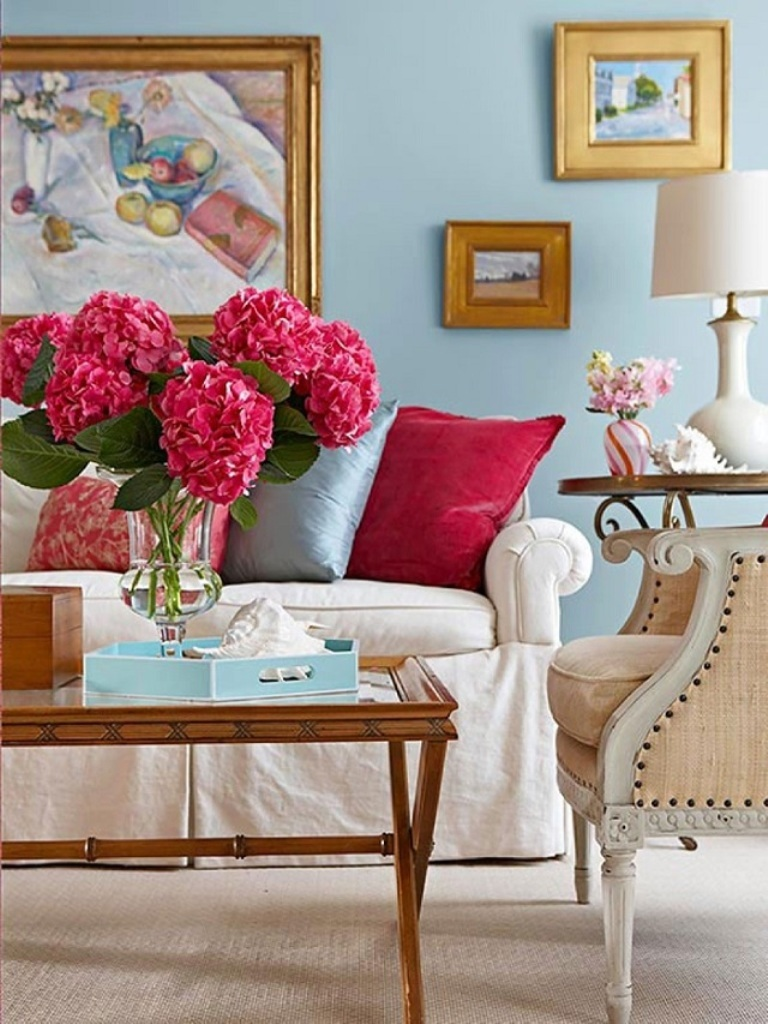 Blue-Wall-Color-with-Beautiful-Flowers-for-Latest-Colour-Combination-for-Summer-Living-Room-with-Gold-Framed-Wall-Art.jpg