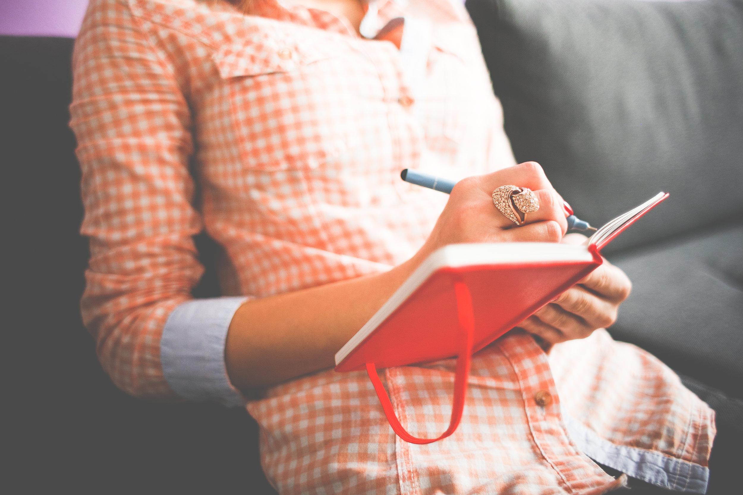 girl-writing-in-her-moleskine-diary-picjumbo-com.jpg