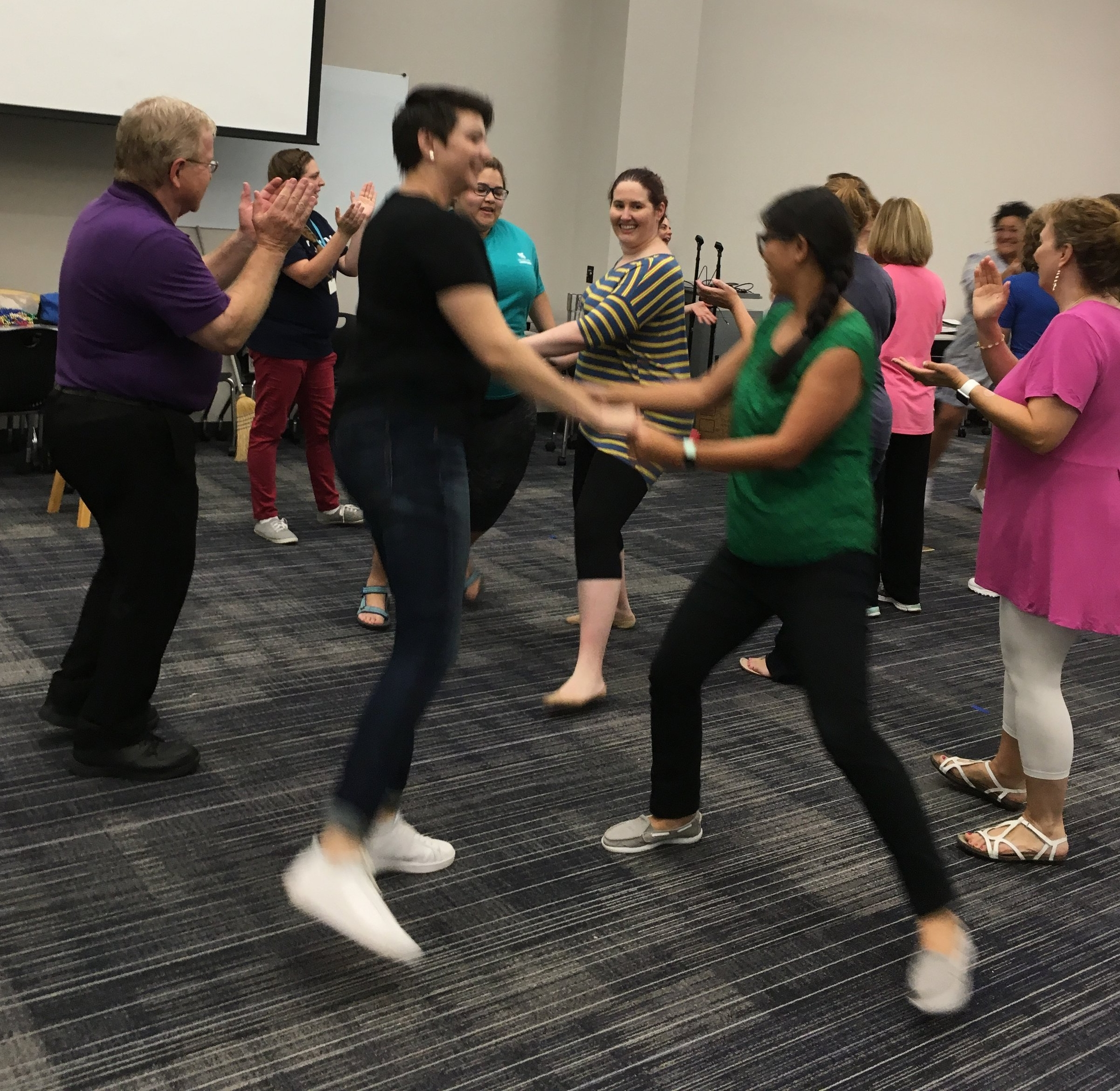 Folk dancing with Klein ISD elementary music teachers at an in-service event, 2018.