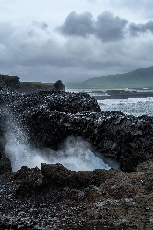Kirkjufjara beach rocks splash small.jpg