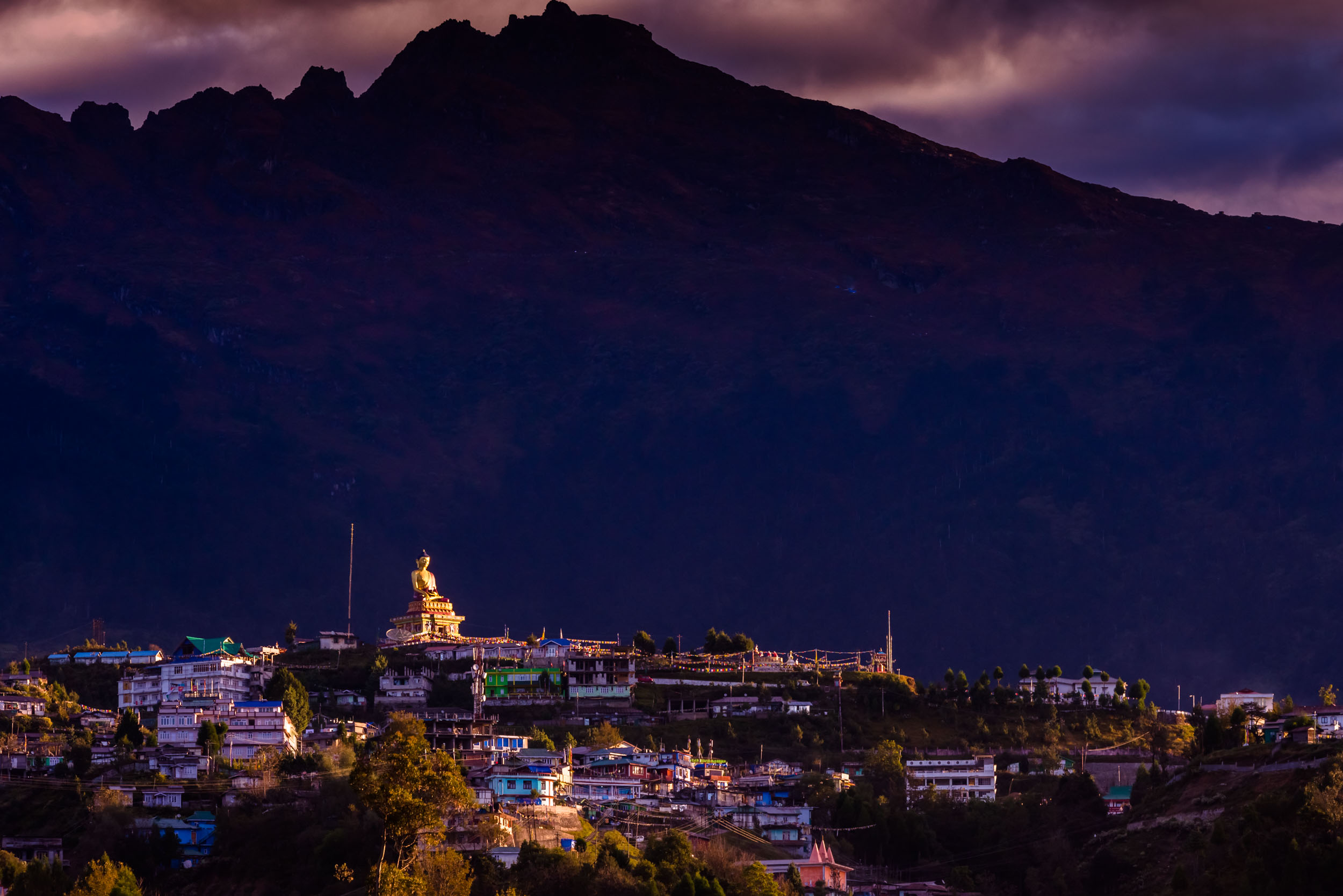 First Ray of Sun on Buddha statue in Tawang town