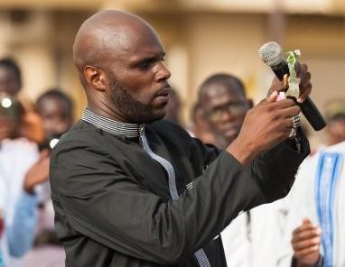 Activist Kemi Seba burns a franc CFA bill in a symbolic anti-CFA protest, Image credit: stopthemaangamizi.com/2017/08/27/president-macky-sall-stop-the-maangamizi-crime-of-detaining-kemi-seba