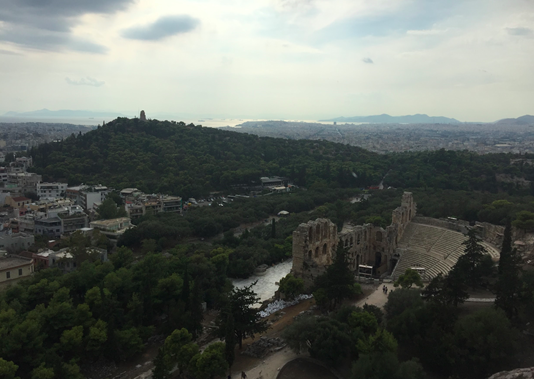 From the top of the Acropolis, the ancient Athenians had a strategic view of three of the central components of their success as a society: the theatre of Odeon of Herodes Atticus, Pnyx hill, and the Saronic Gulf beyond.  Image credit: Sofia Kalogirou