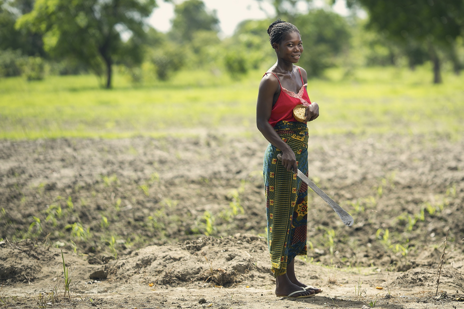 Female farmer from a rural African community. Cabo Delgado is overwhelmingly rural, with FID potentially de-risking investments into rural real assets, including agriculture and forestry. Photo credit: Pochogh