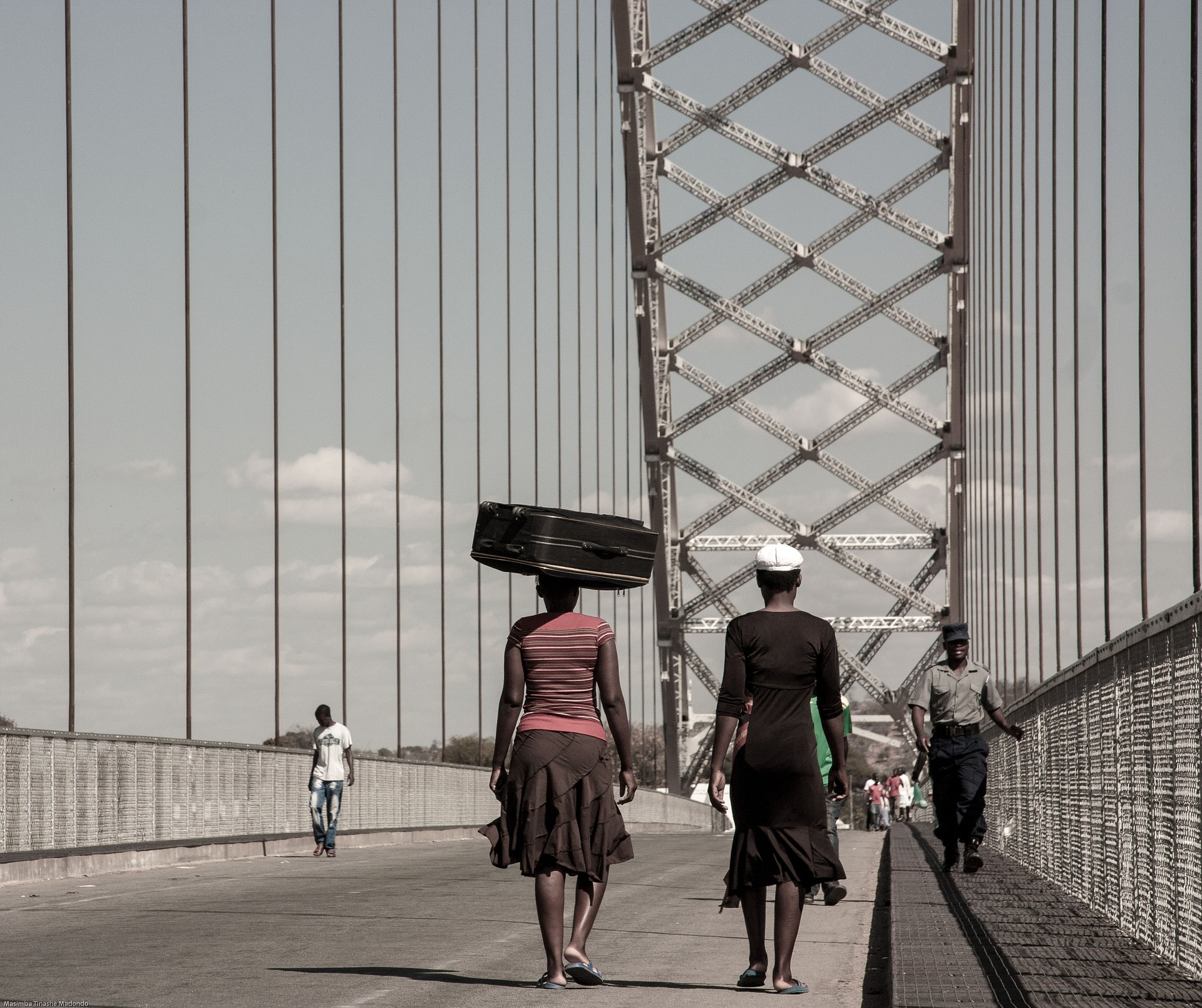 Citizens crossing a bridge. Mozambique's new Maputo-Catembe bridge is an example of an infrastructural investment that can facilitate increased mobility, better transport and economic benefits. Photo credit: 1388843