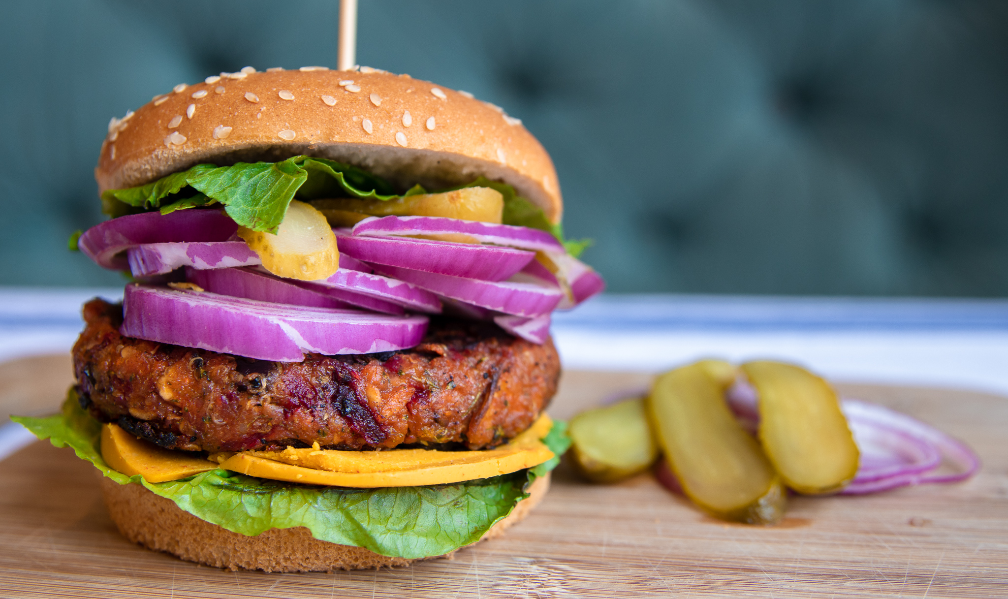 If you have been on the hunt for a healthy, and hearty homemade veggie burger, I think we have what you have been looking for.  This smokey, flavorful  burger is packed full of veggies, with protein rich quinoa and black beans. This burger will leave you full, and satisfied with little guilt.. They also freeze really well, so this veggie burger is also great for meal prep! So fire up the grill and give this healthy and delicious burger recipe a try!