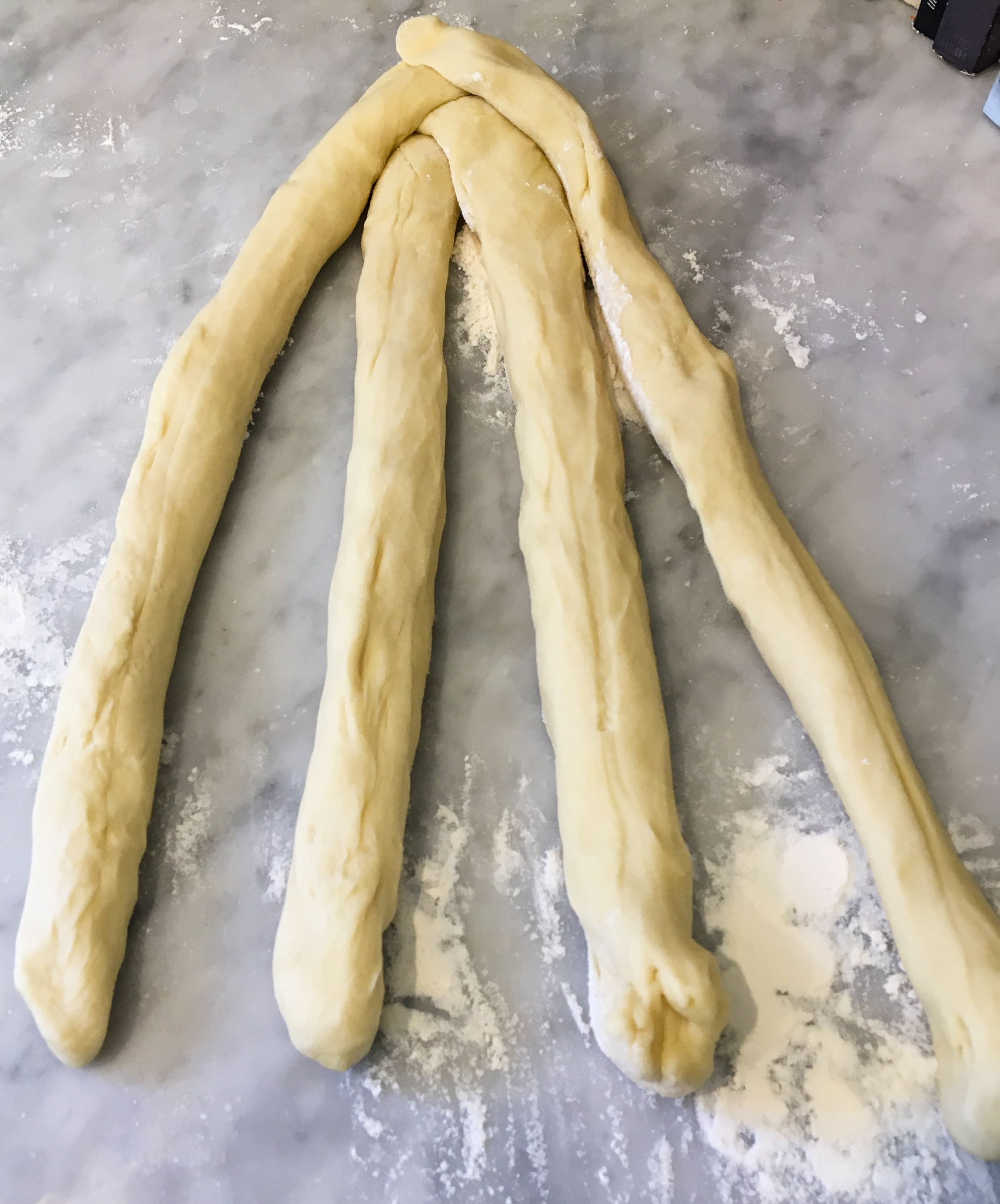 - Separate your dough into 4 equal pieces and begin forming
