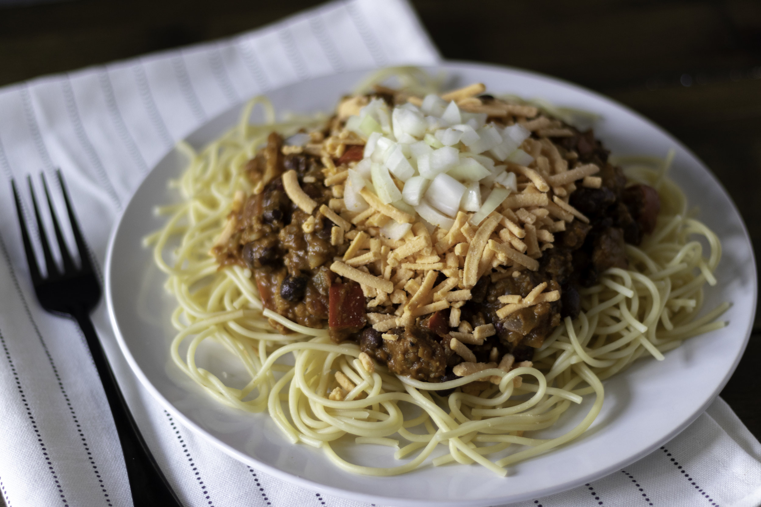 I grew up in the south, so Cincinnati chili is not something I had ever even heard of until I was a teenager. It seemed very odd to me to be topping pasta with chili and cheese, and I could not get behind this idea. That was until I was an adult and a friend served it to me. I HAD BEEN SO WRONG. Not only does it work, but it's delicious. I hate to admit it, but obviously we don't know everything here in the south, because we didn't know about this magic! Also, don't worry about the pumpkin in this Cincinnati chili recipe. It just makes it a little less acidic since we are using less tomato than usual. It adds a thickness we need, and along with the cauliflower and beans, makes for a super healthy and hearty chili! So if you are from the south and have never had Cincinnati chili either, just do it. I promise we will not revoke your southern card!