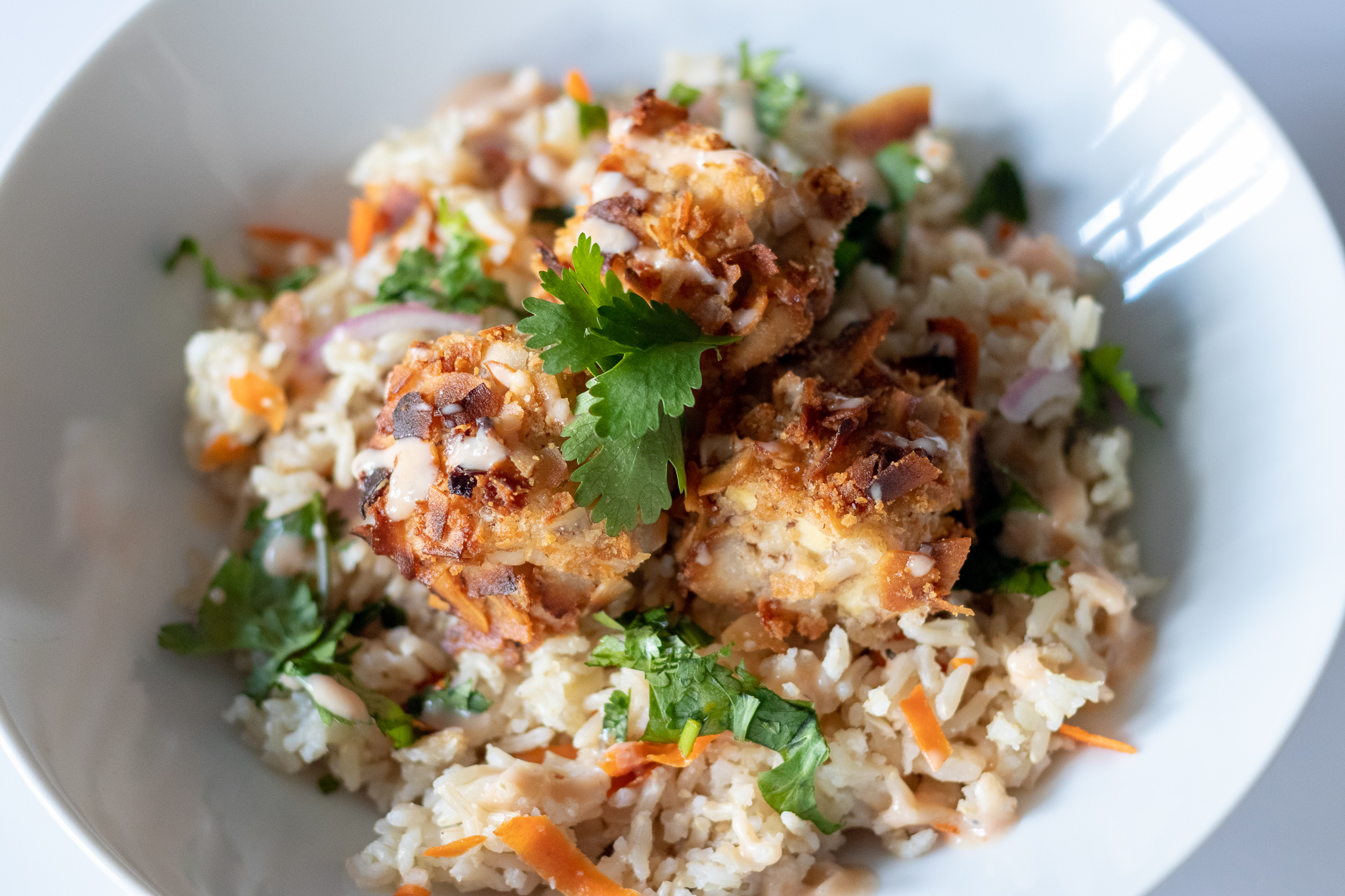 This coconut tofu with tropical rice is perfect for quick and easy weeknight dinner. It is light, yet filling and satisfying. The tofu is crispy, and full of sweet coconut flavor, while the rice savory and refreshing. This may just become one of your new favorite quick dinners!