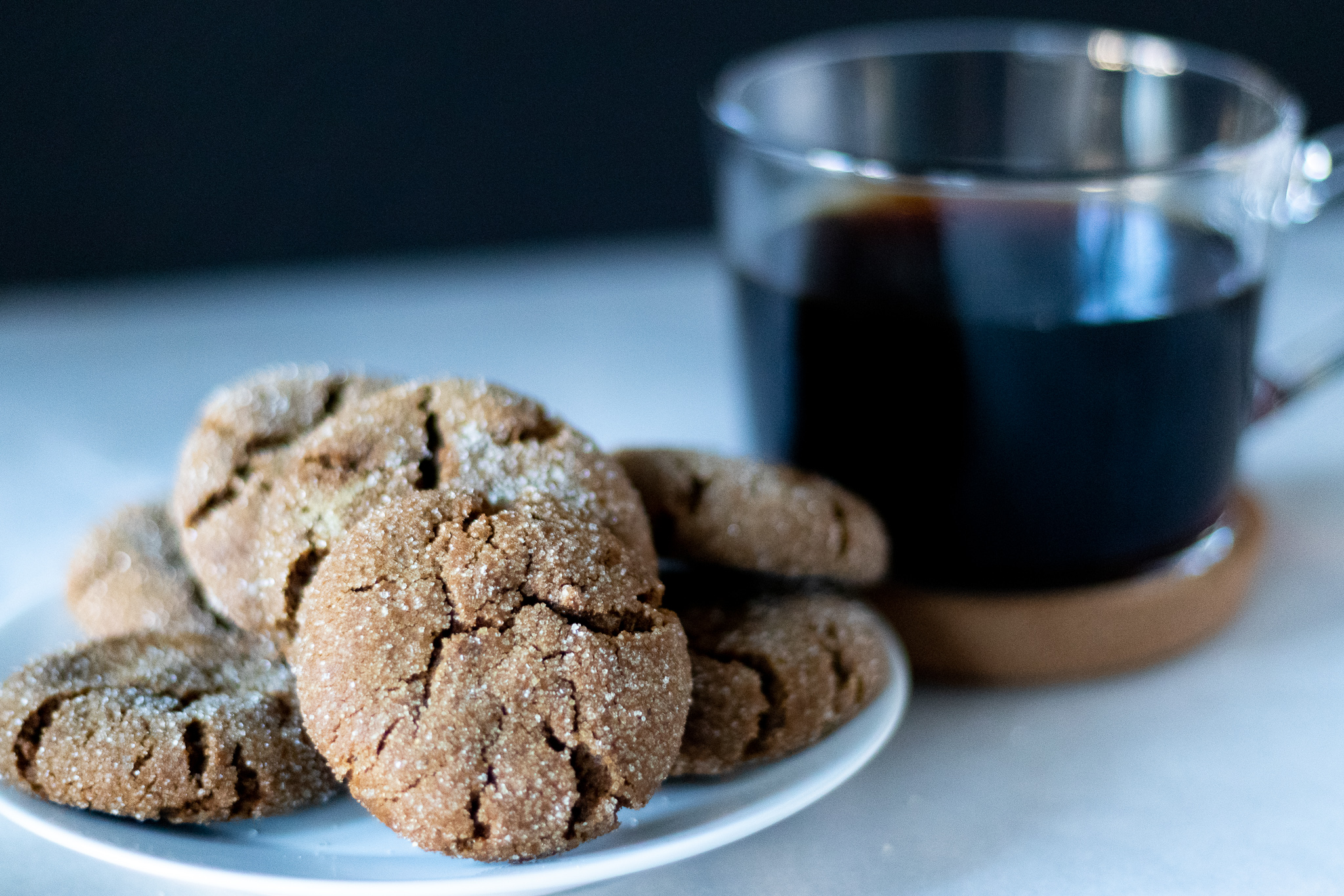 """What screams """"HOLIDAYS!"""" more than ginger bread. These soft vegan ginger cookies are one of my favorite holiday treats. Serve these with a cup of hot coffee, or a glass of vegan egg nog, and you will have no problem getting right into the holiday spirit. Bake up some extra to gift to friends and family and help spread some holiday cheer this season!"""