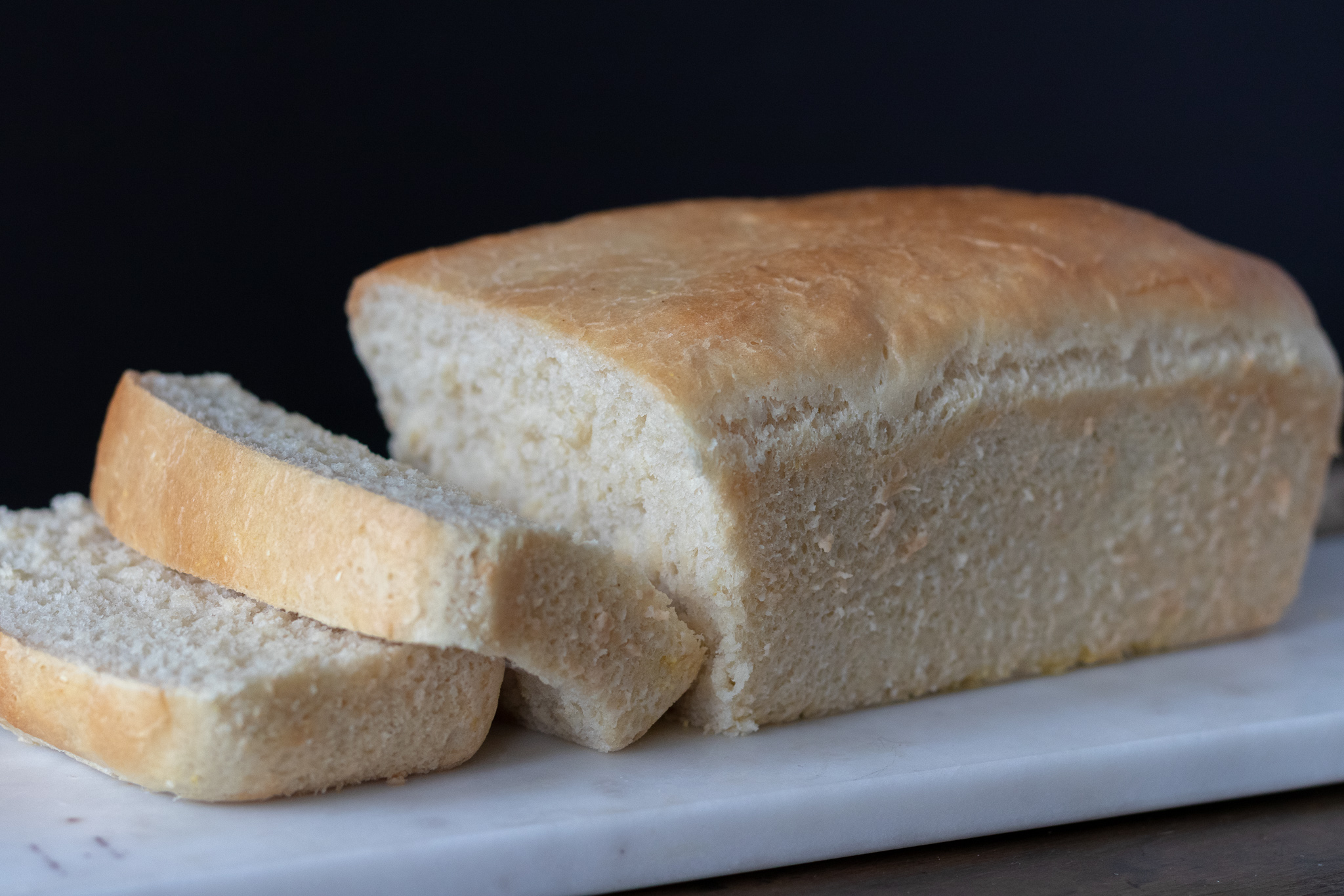 """I love to smell fresh bread baking. Carbs are my weakness. I actually have a necklace that I wear often that says """"carbs"""" with a heart engraved on it. So you can see my love for bread and all things carbs runs deep. I really, really love a nice big delicious sandwich on fresh baked bread! If you have never made loaf bread, let me tell you, you are missing out. You do not need a fancy bread machine to make easy and fresh baked bread either! Just a loaf pan and an oven. I am always amazed at just how many ingredients are in store bought bread, half of which I do not know what they are ,or how to pronounce. So I end up paying $5 or more for a loaf of vegan organic, healthier bread, which will be gone after my family of 6 make a sandwich. Homemade vegan bread is far cheaper, and much healthier than most store bought options, and its easy to make! You can easily double this recipe as well, and bake up two loaves at once if you are like us and have a lot of mouths to feed. It also freezes well so you could bake up 2 loaves,and just freeze one for later!!! So to all you other carb lovers out there, may your bread always be fresh, fluffy, and make you super happy!!"""