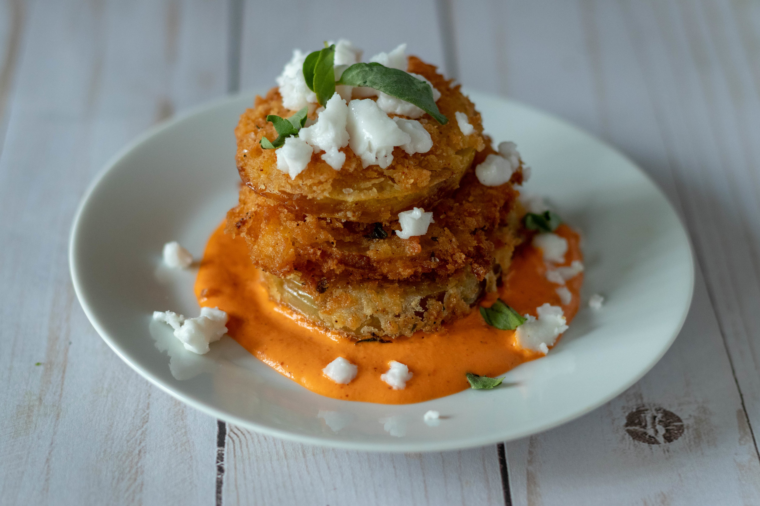 Delicious fried green tomatoes with non dairy goat cheese