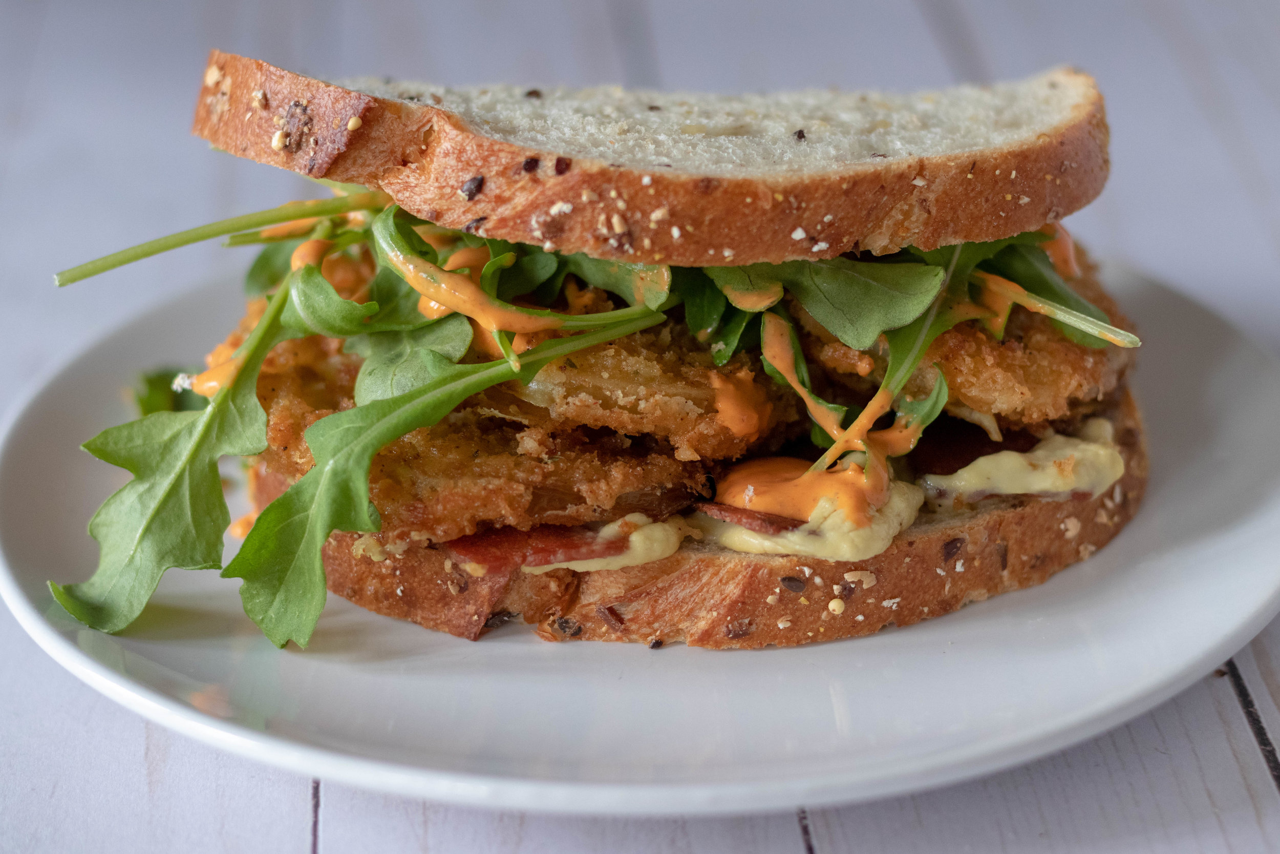 Fried green tomato and arugula sandwich.