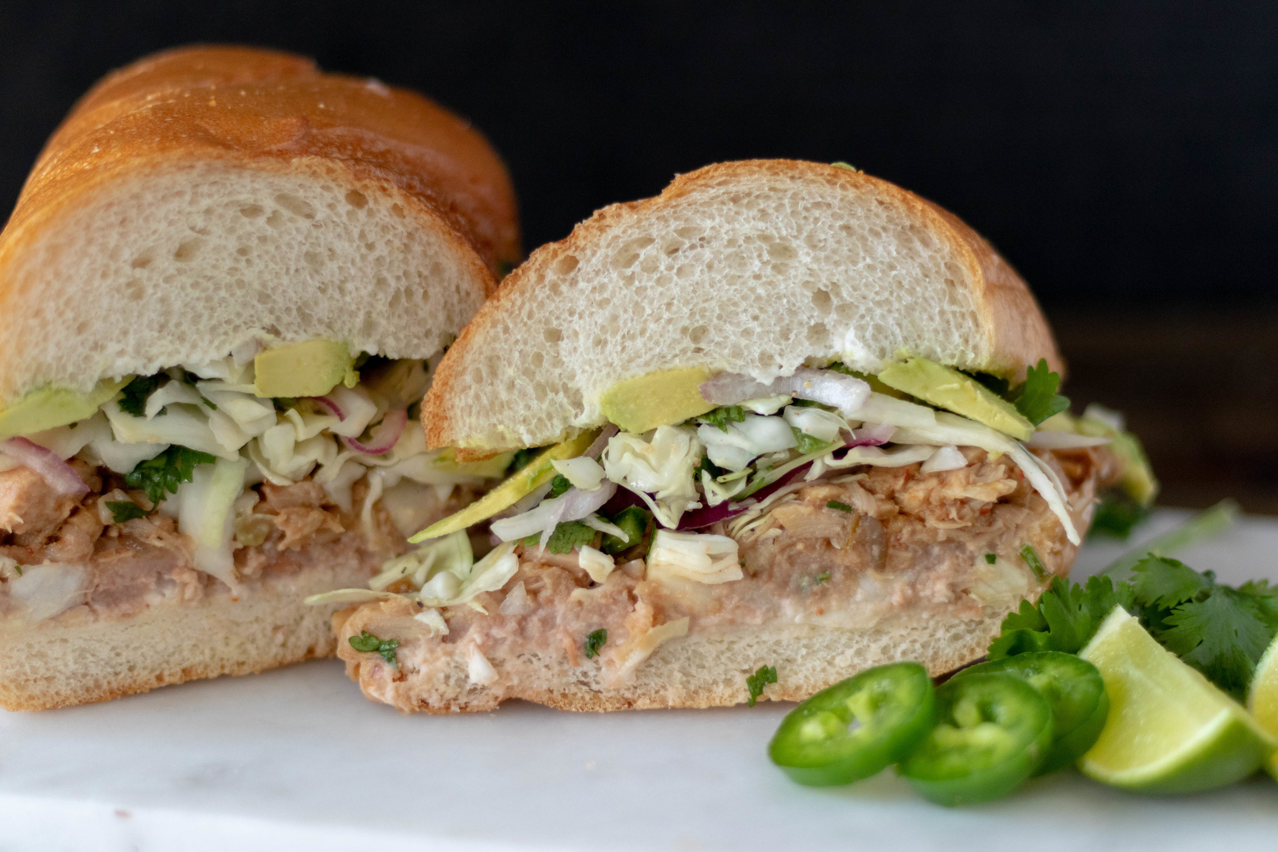 Pulled Jackfruit Mexican Torta cut in half.