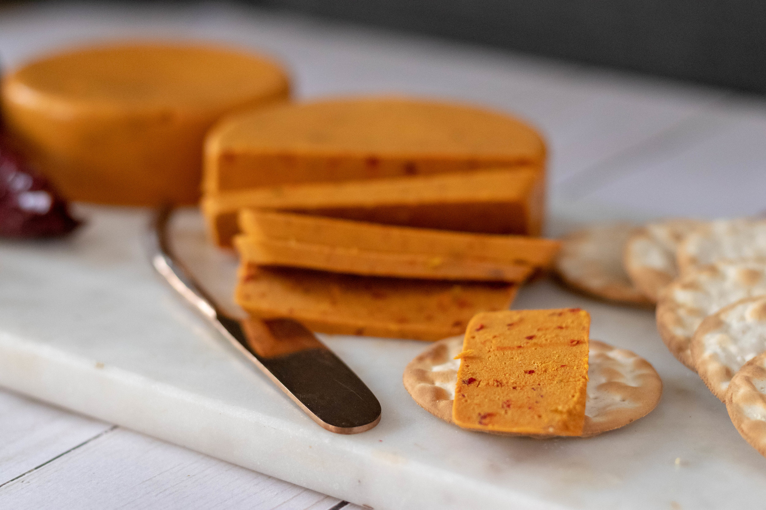 Vegan Smokey Chile Cheddar Cheese on a cracker