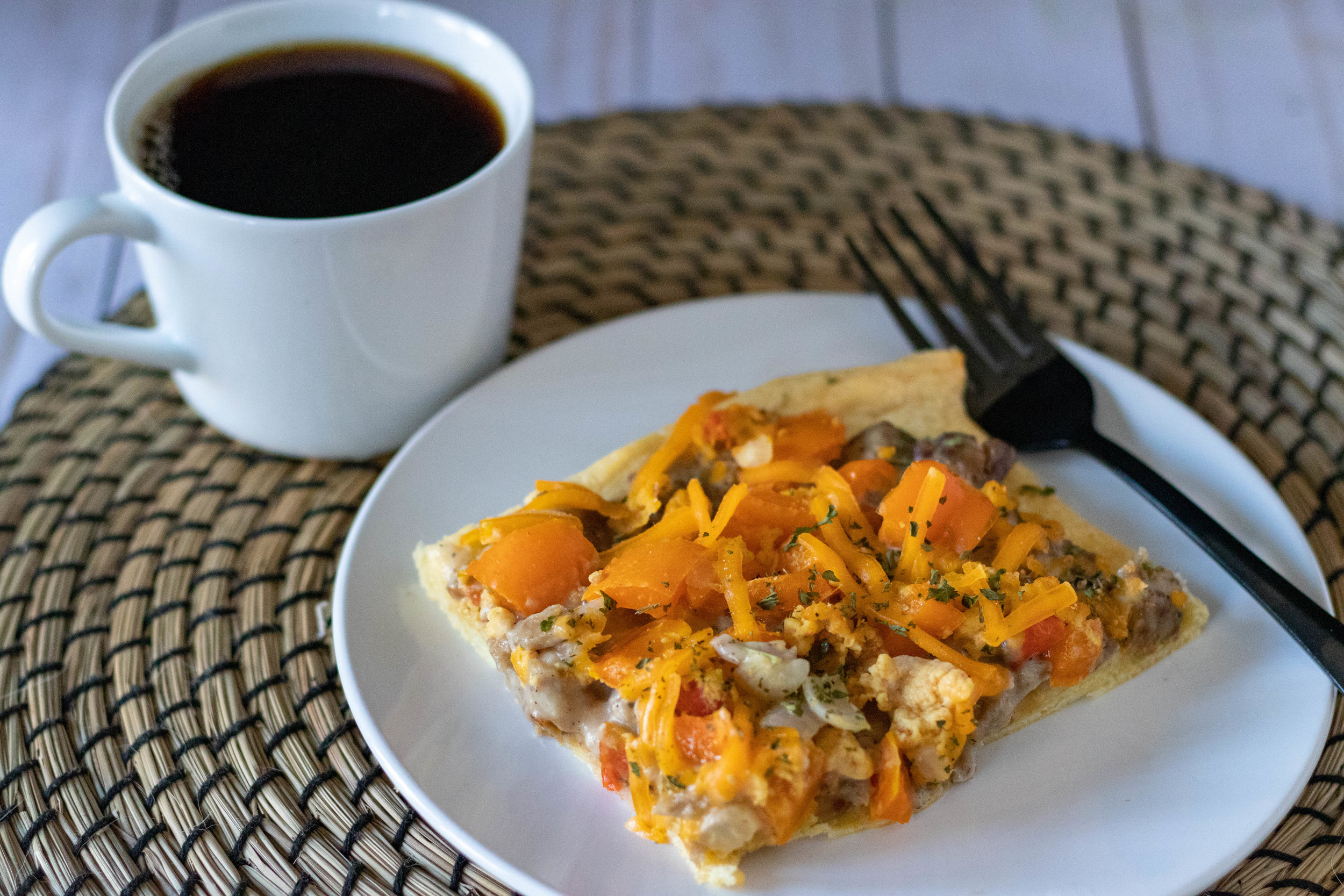 Vegan breakfast pizza served with a cup of coffee