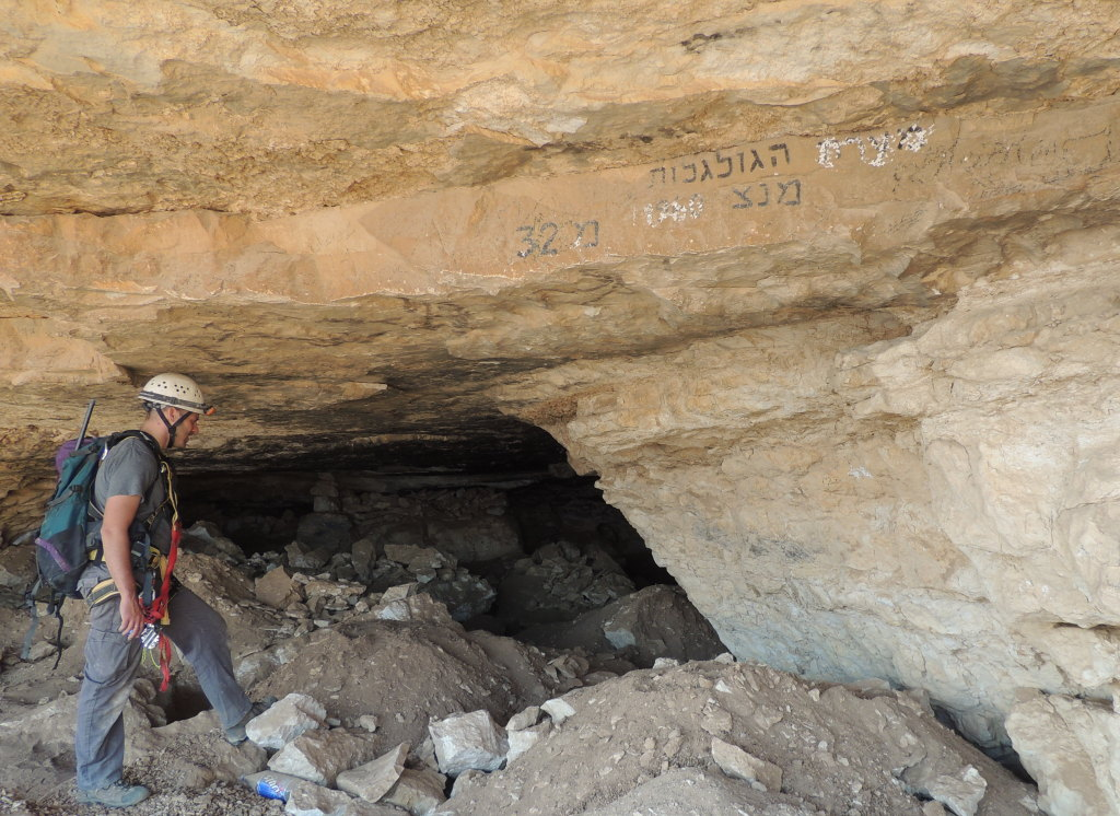 Inspecting 'Skulls Cave' in the Judean Desert after catching a gang looting remains within.