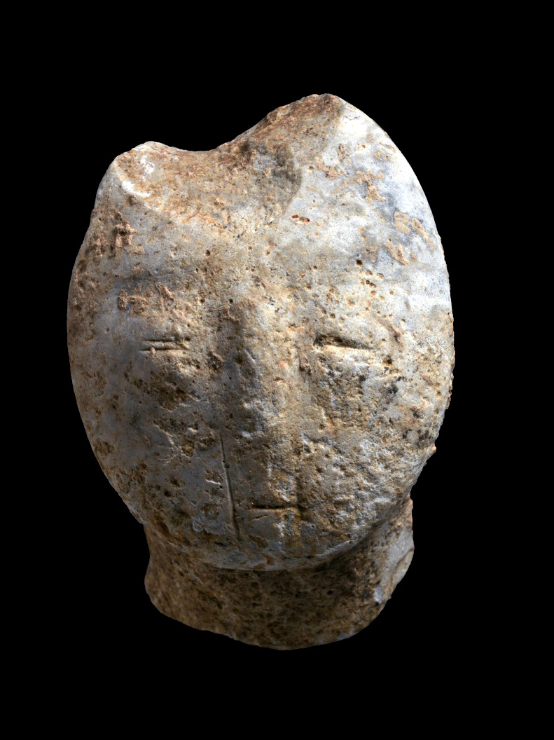 9,000 years old figurine, depicting a human face.