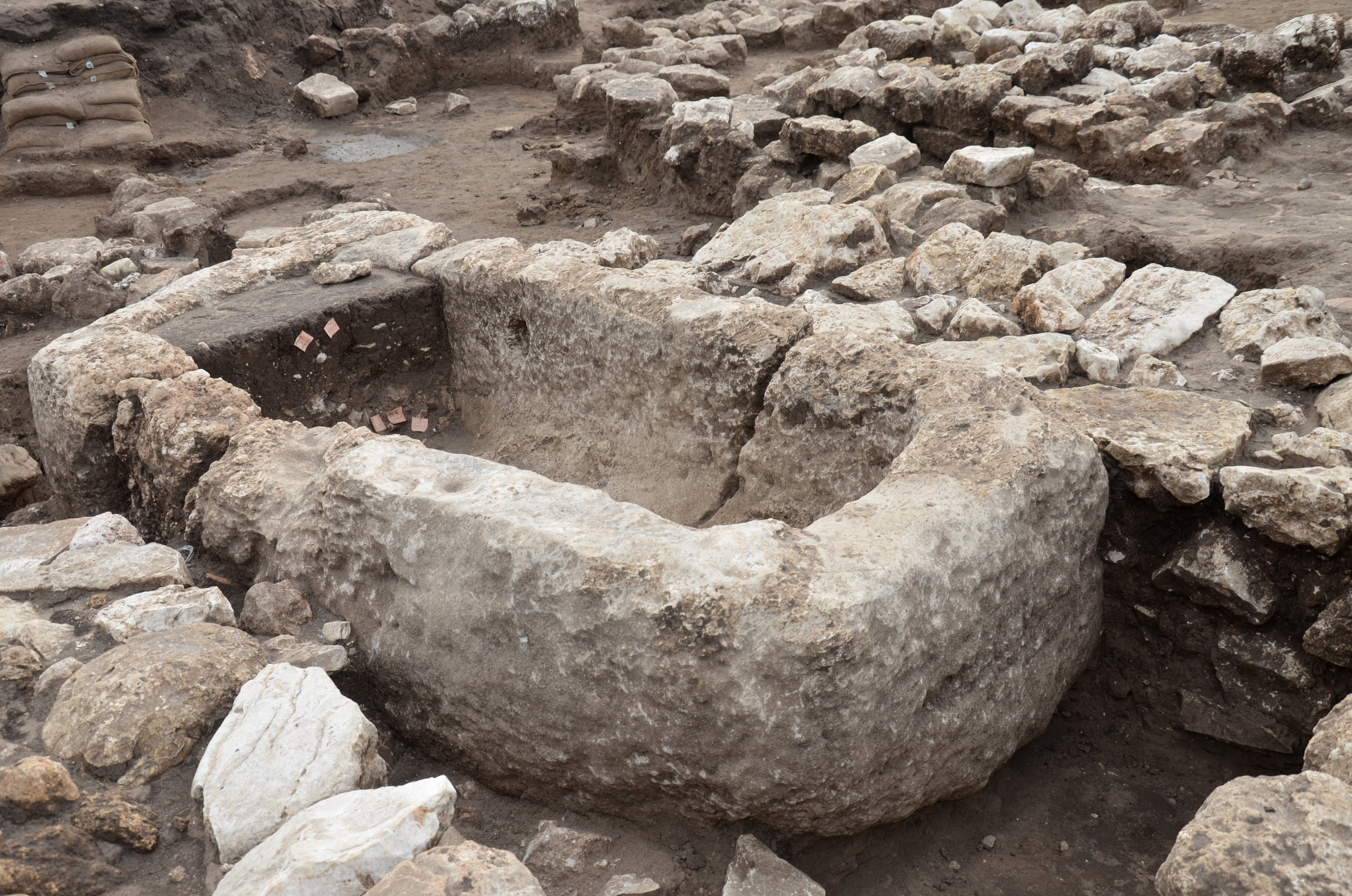 A stone basin for liquids, apparently used for religious rituals.  Photo: Yoli Schwartz, Courtesy of the Israel Antiquities Authority