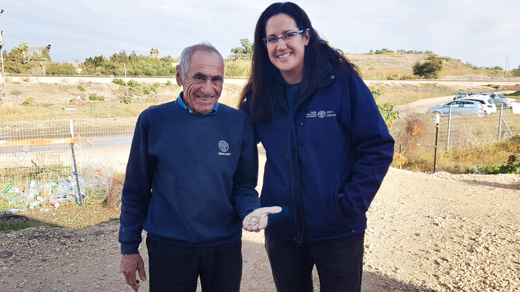 Liat Nadav-Ziv and Marc Molkondov with the hoard.  Photo: Amihai Tamir, courtesy of the Israel Antiquities Authority