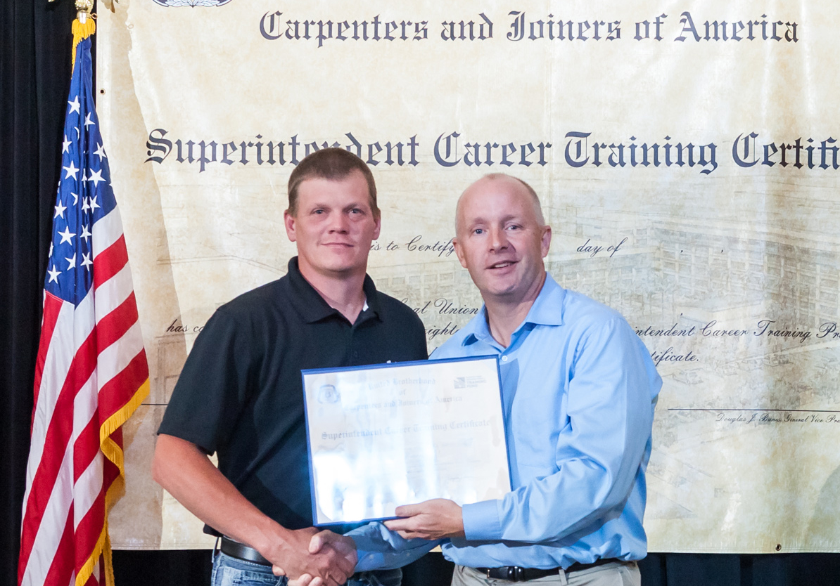 Pangere employee accepting certification