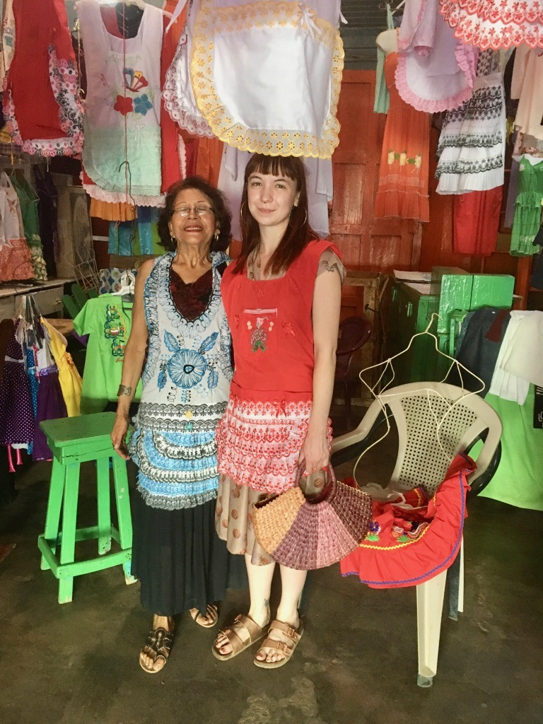 Purchasing beautiful handmade aprons from this sweet abuela
