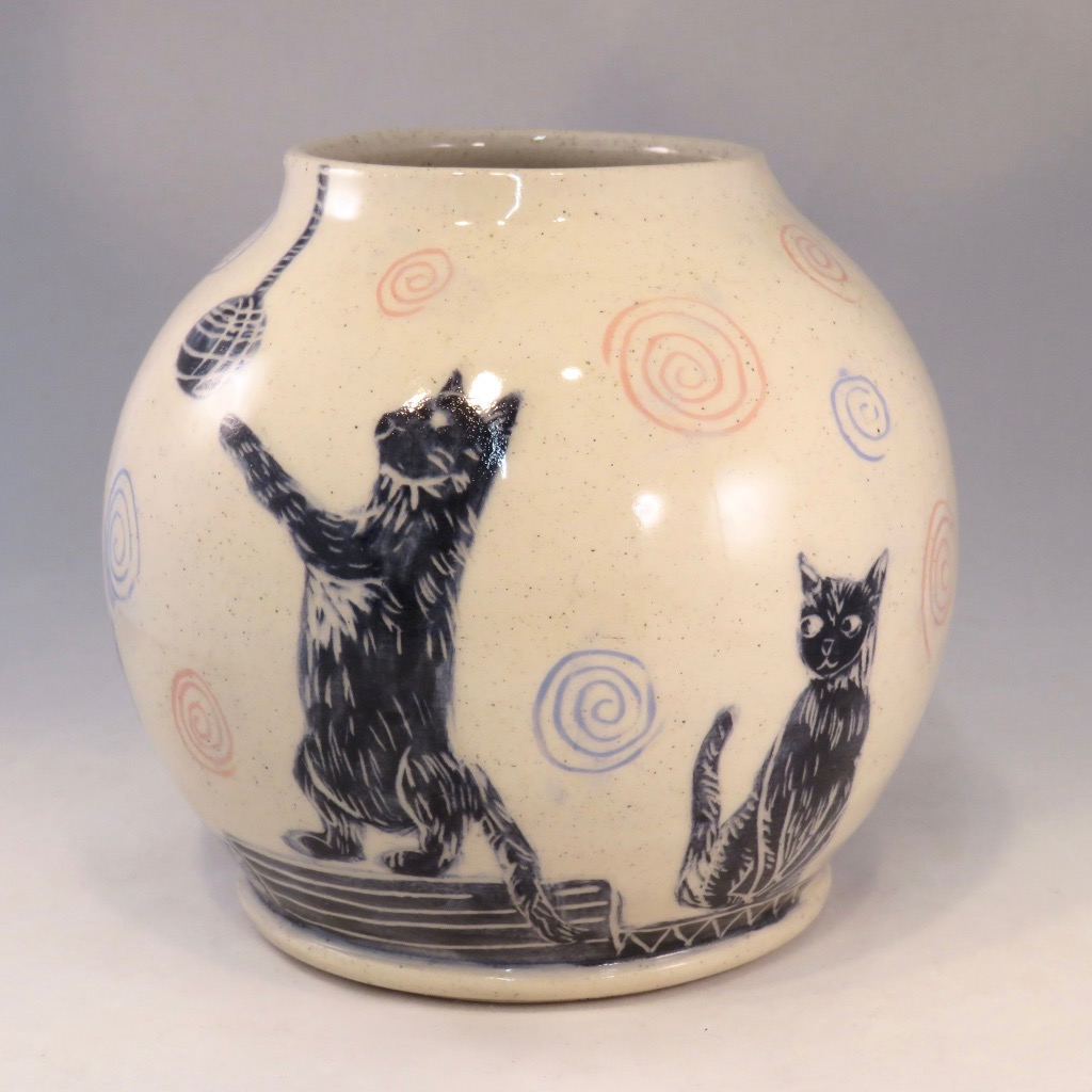 cats playing vase