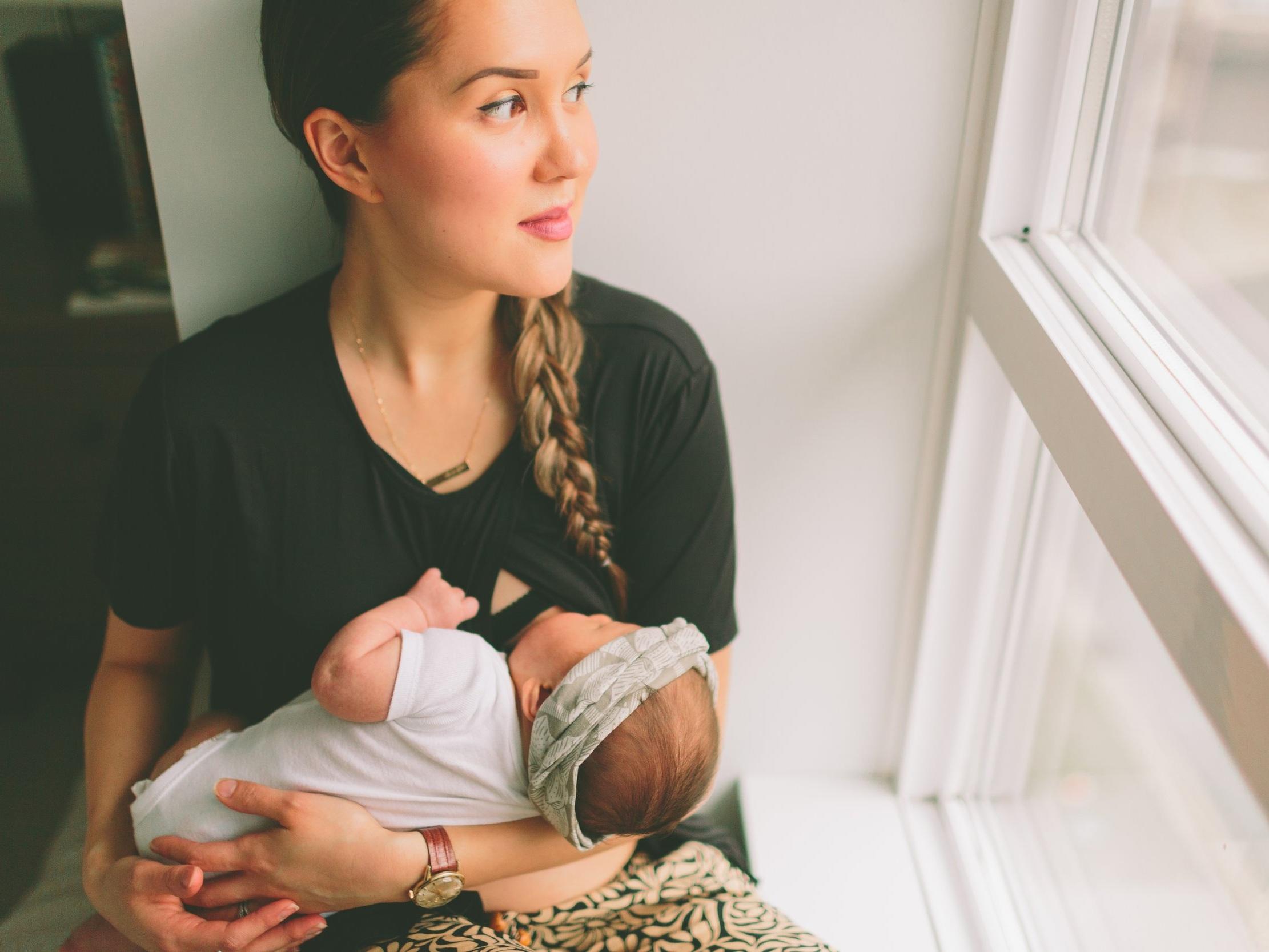 New mom breastfeeding newborn baby