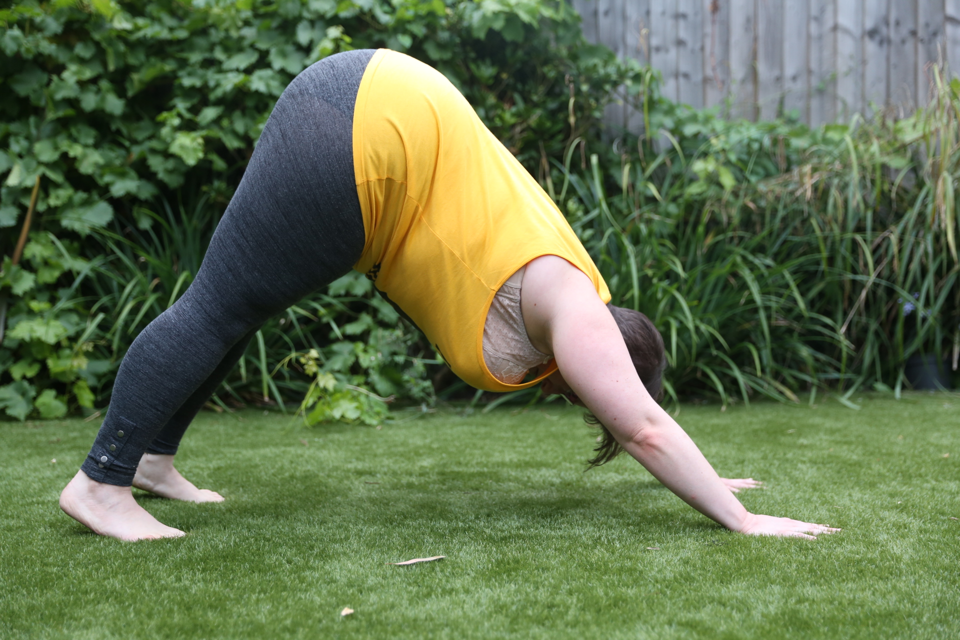 Yoga teacher Miriam Zendle in downward dog