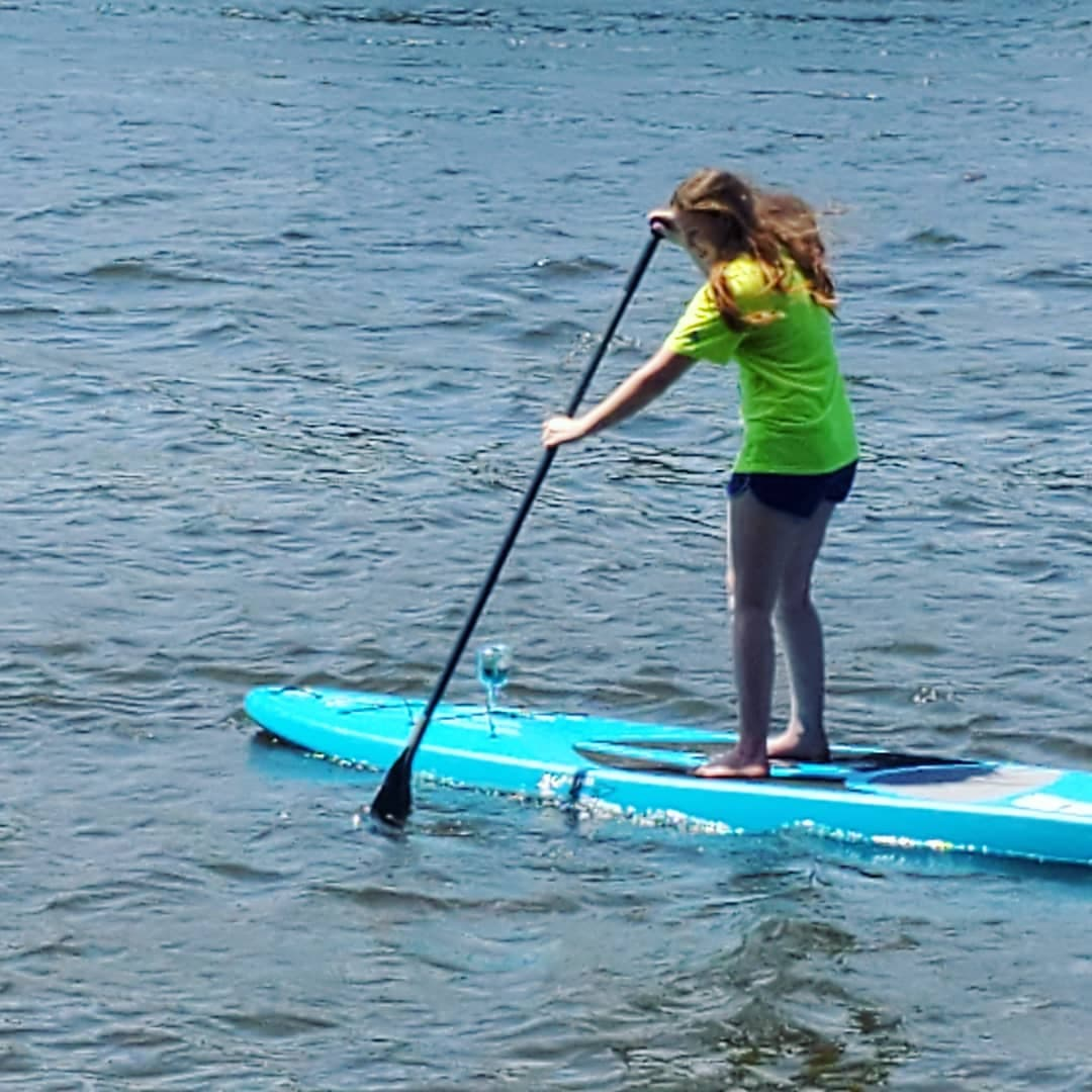 Woman riding paddle board