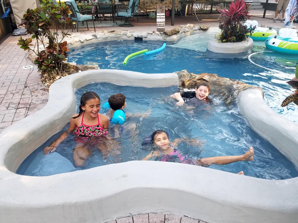 Kids having fun in the tropical pool