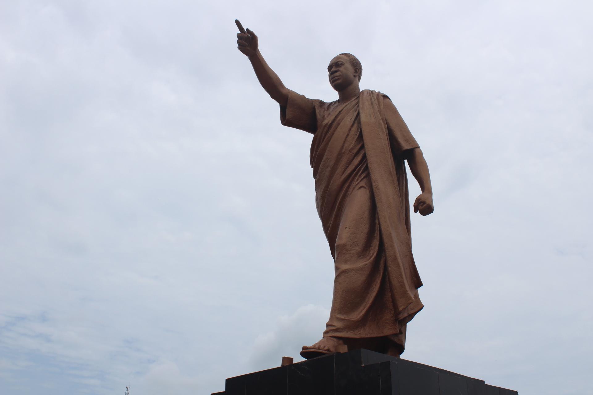 "A statue of Kwame Nkrumah symbolizing his slogan, ""Forward ever, backwards never."