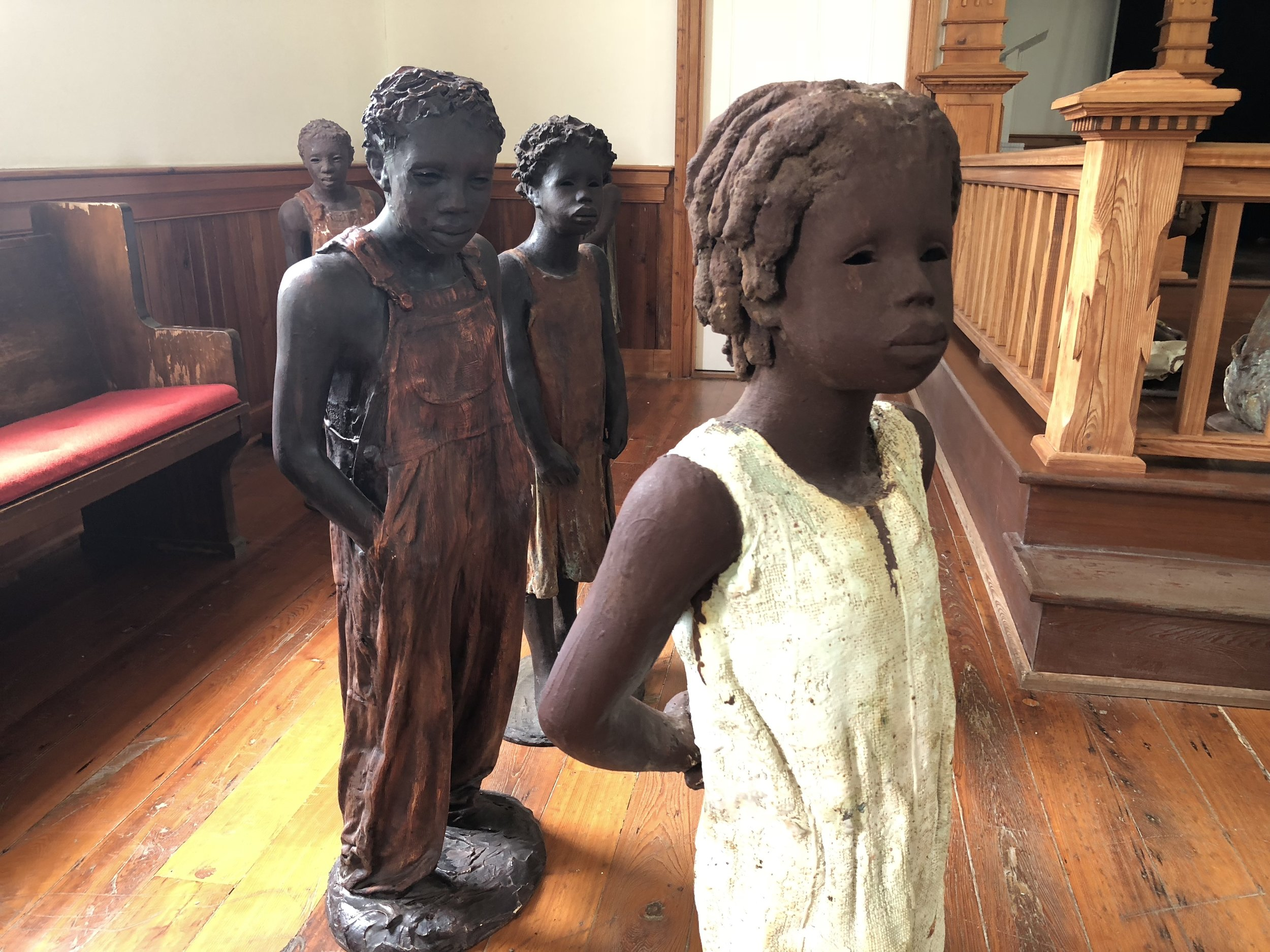 The statues of slave children inside the church