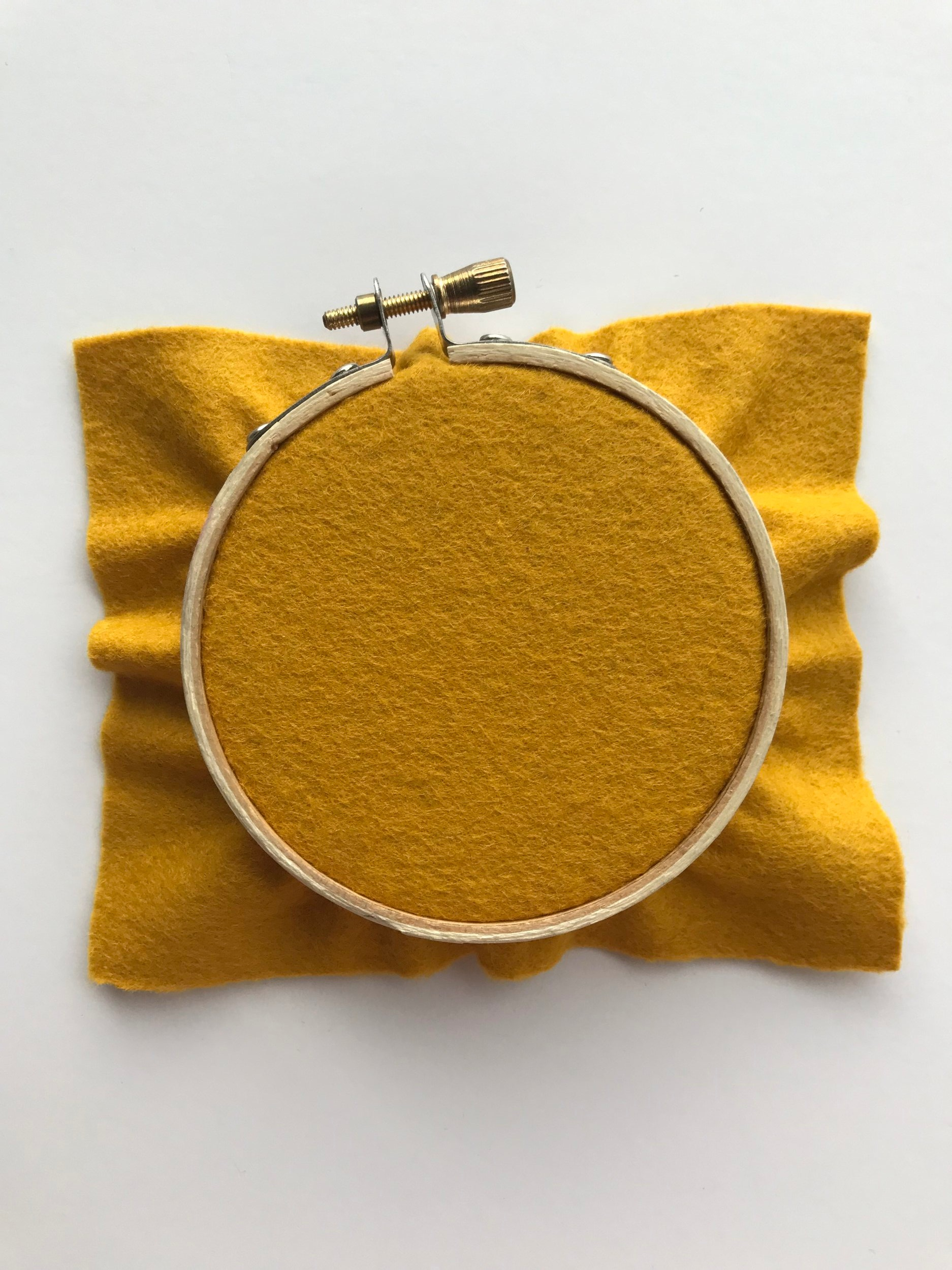 Place the fabric on the embroidery hoop.