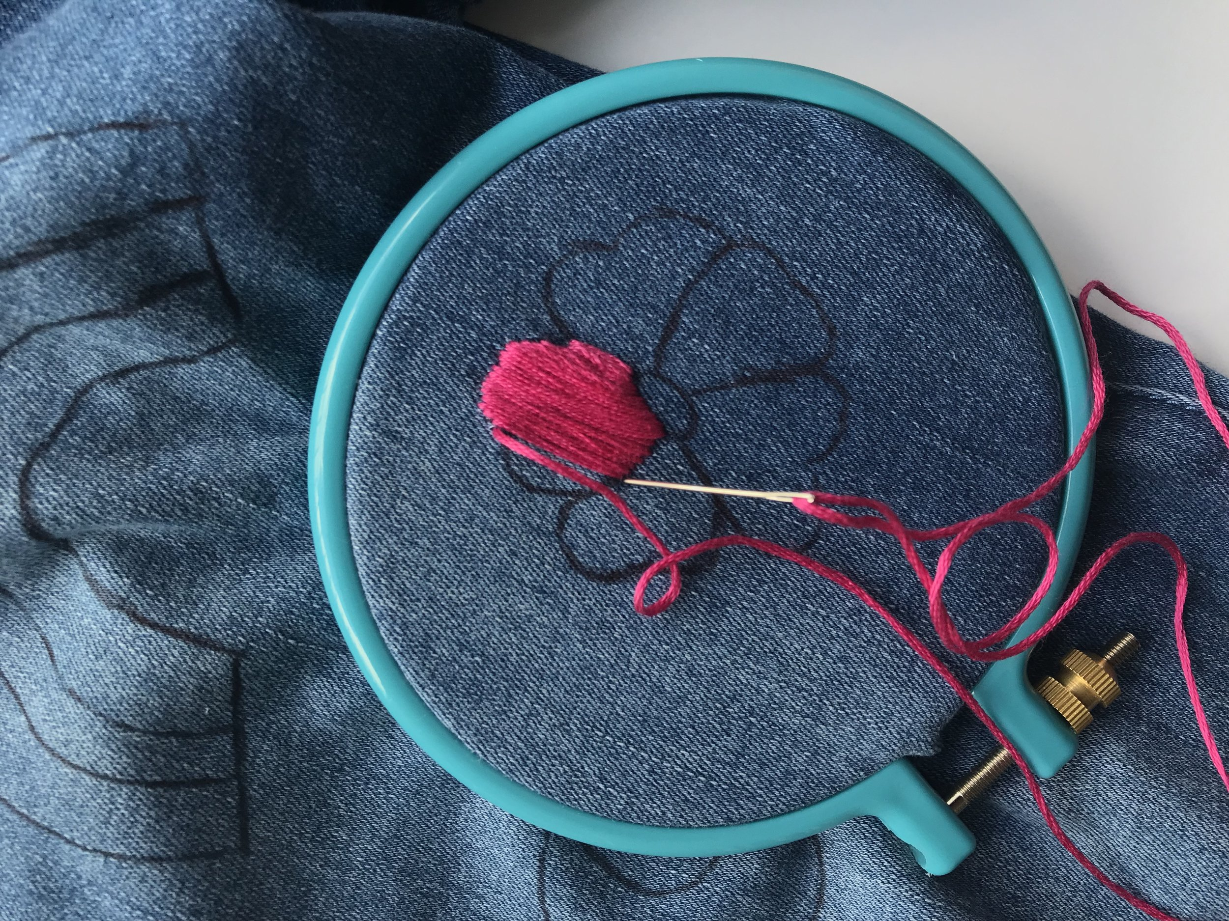 Place the embroidery hoop around your design and begin stitching. I used a straight stitch for this flower. Next time; I'll probably use 3 out of the 6 threads for a flatter look.