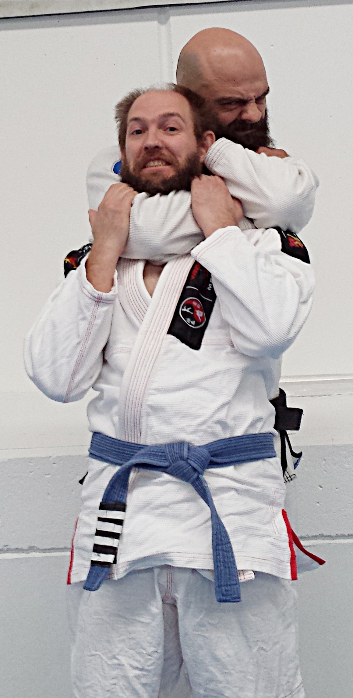 Declan with his Gracie Jiu-Jitsu teacher, Phillip Grapsas. - Since 2012, Declan has learnt Gracie Jiu-Jitsu from self-defence expert, Phillip Grapsas, a renowned first degree black belt in Brazilian Jiu-Jitsu under eighth degree coral belt, Master Pedro Sauer. Declan received his blue belt in 2015, his fourth stripe in 2018, and is on track to receive his purple belt in 2019.