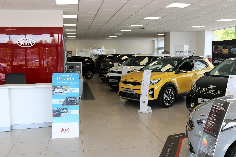 Multi-car Kia branded showroom