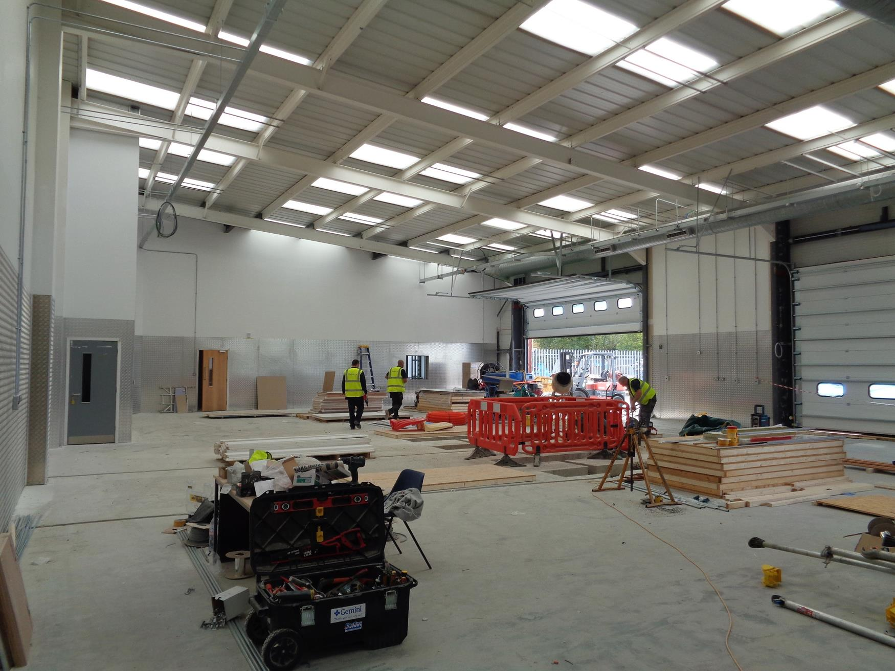 Ceiling and flooring in new car workshop