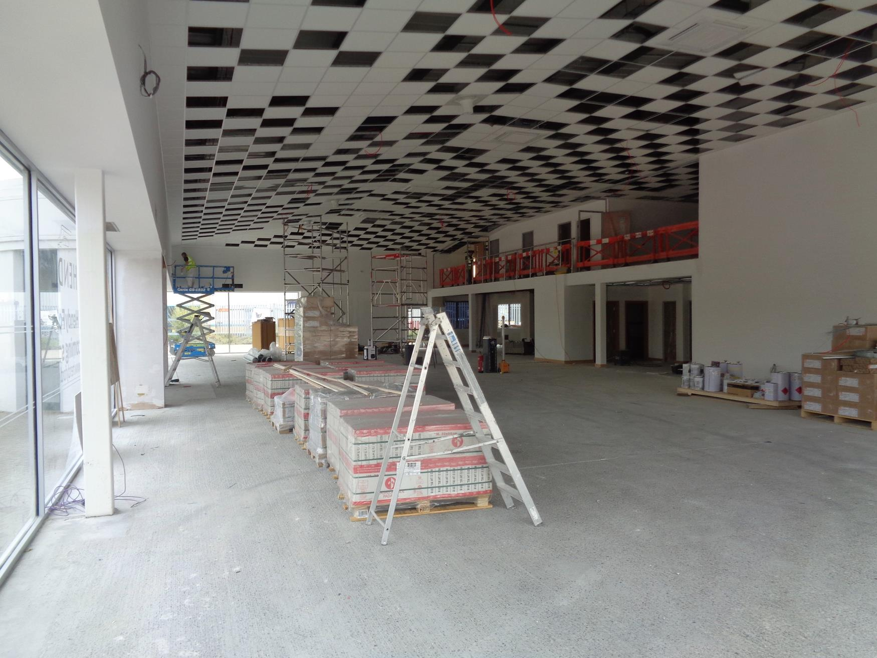 Ceiling raised to maximise space in showroom