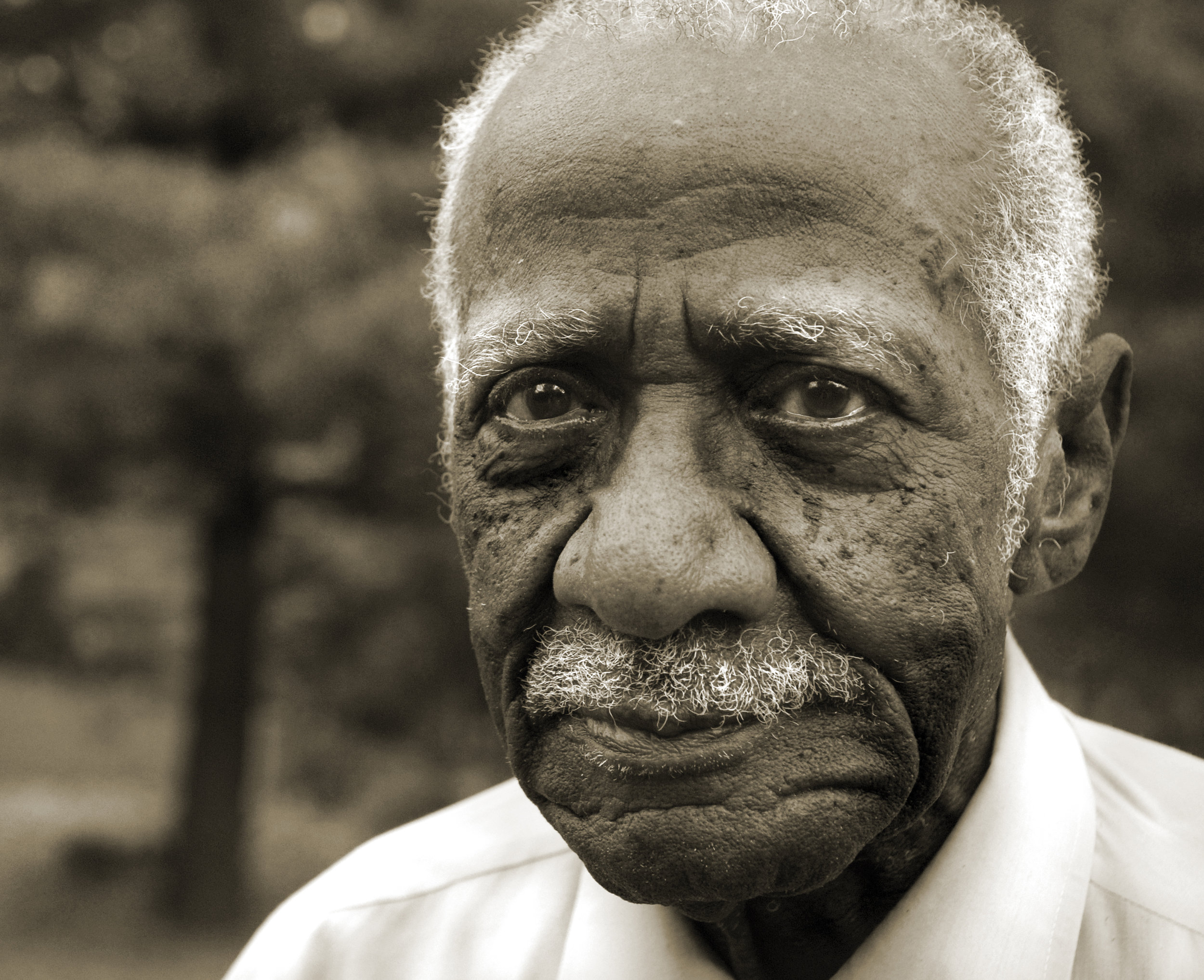 """Broomsy Salter (pictured at 94 years old) became the first African-American in Freeport, Illinois to move across the """"color line"""" in 1956, when he bought land from a Jewish man and built a house. Until 1966, African-Americans were restricted to buying, renting, and leasing east of Illinois 26. The east side of Freeport has a flood plain."""