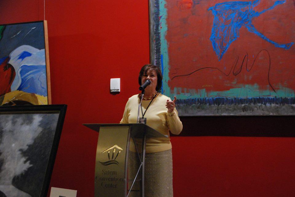SCC 10th anniv Anna Peterson speaks Carl Hall ptg in front.jpg