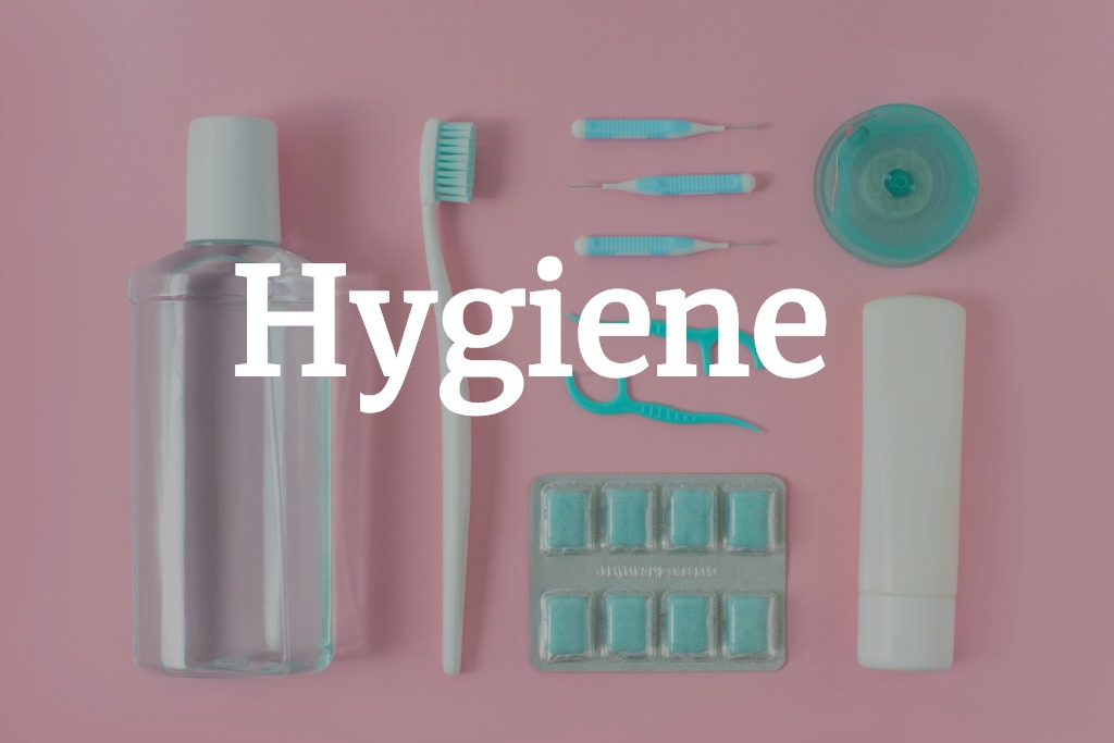 toothbrushes-toothpaste-rinse-and-chewing-gum-set-on-pink-background-picture-id931307960 (2).jpg